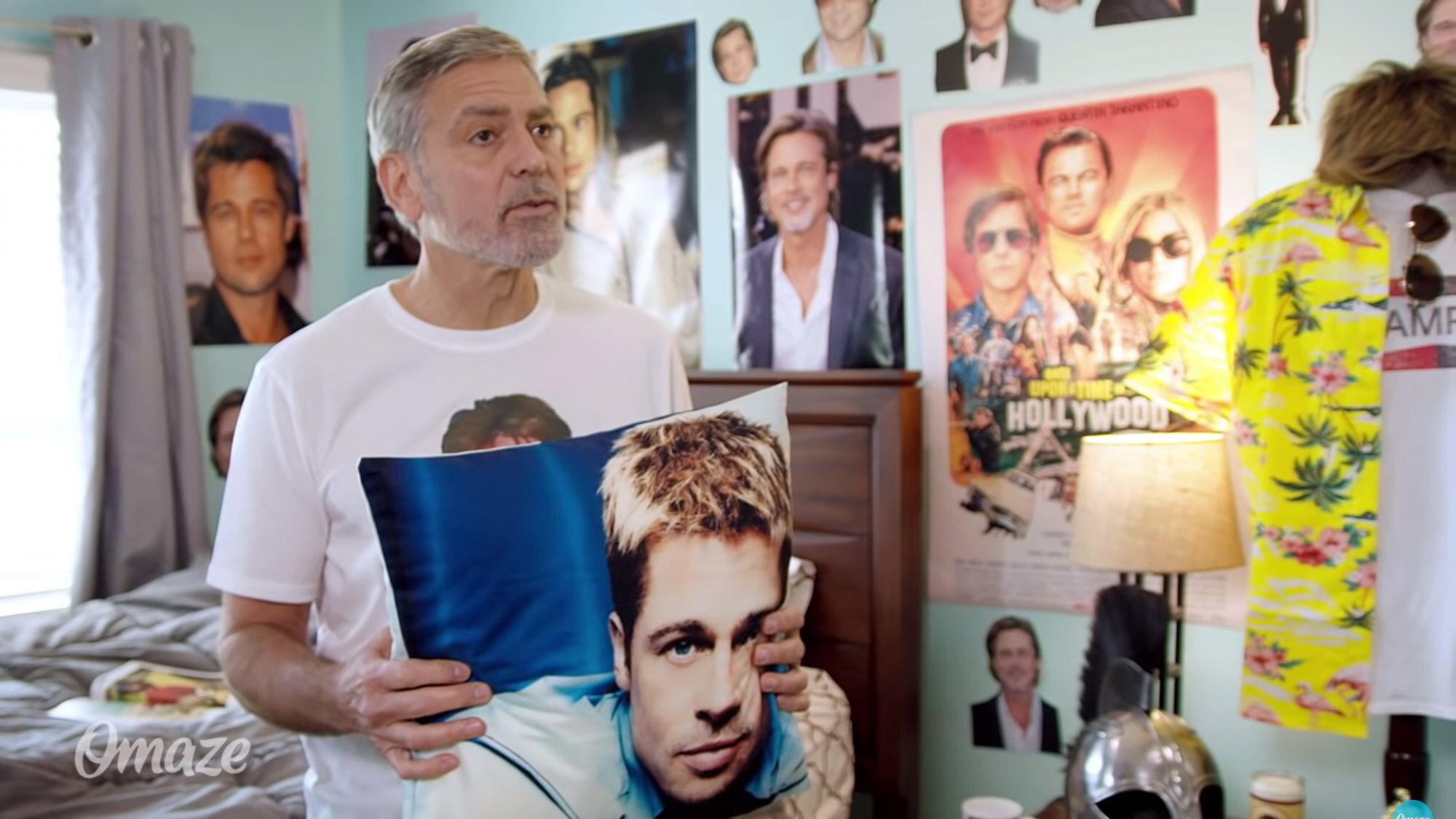 George Clooney Is Really Obsessed with Brad Pitt in Hilarious Charity Video: 'He's So Good!' Image?url=https%3A%2F%2Fstatic.onecms.io%2Fwp-content%2Fuploads%2Fsites%2F20%2F2021%2F05%2F05%2Fgeorge-clooney-2000
