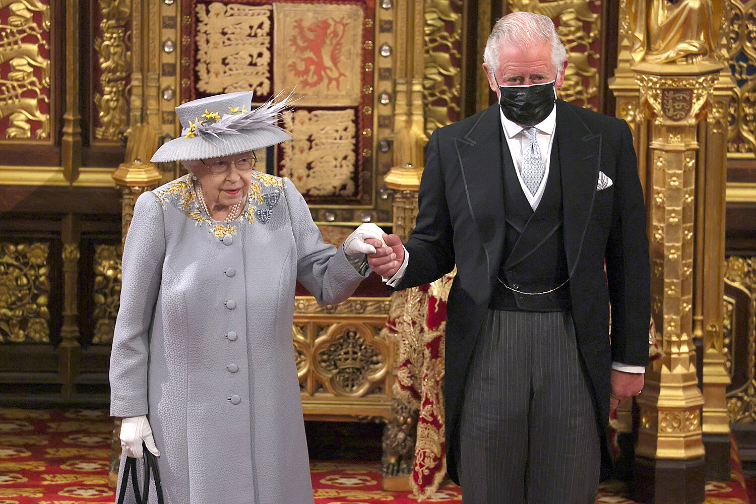 Queen Elizabeth II arrives with Prince Charles