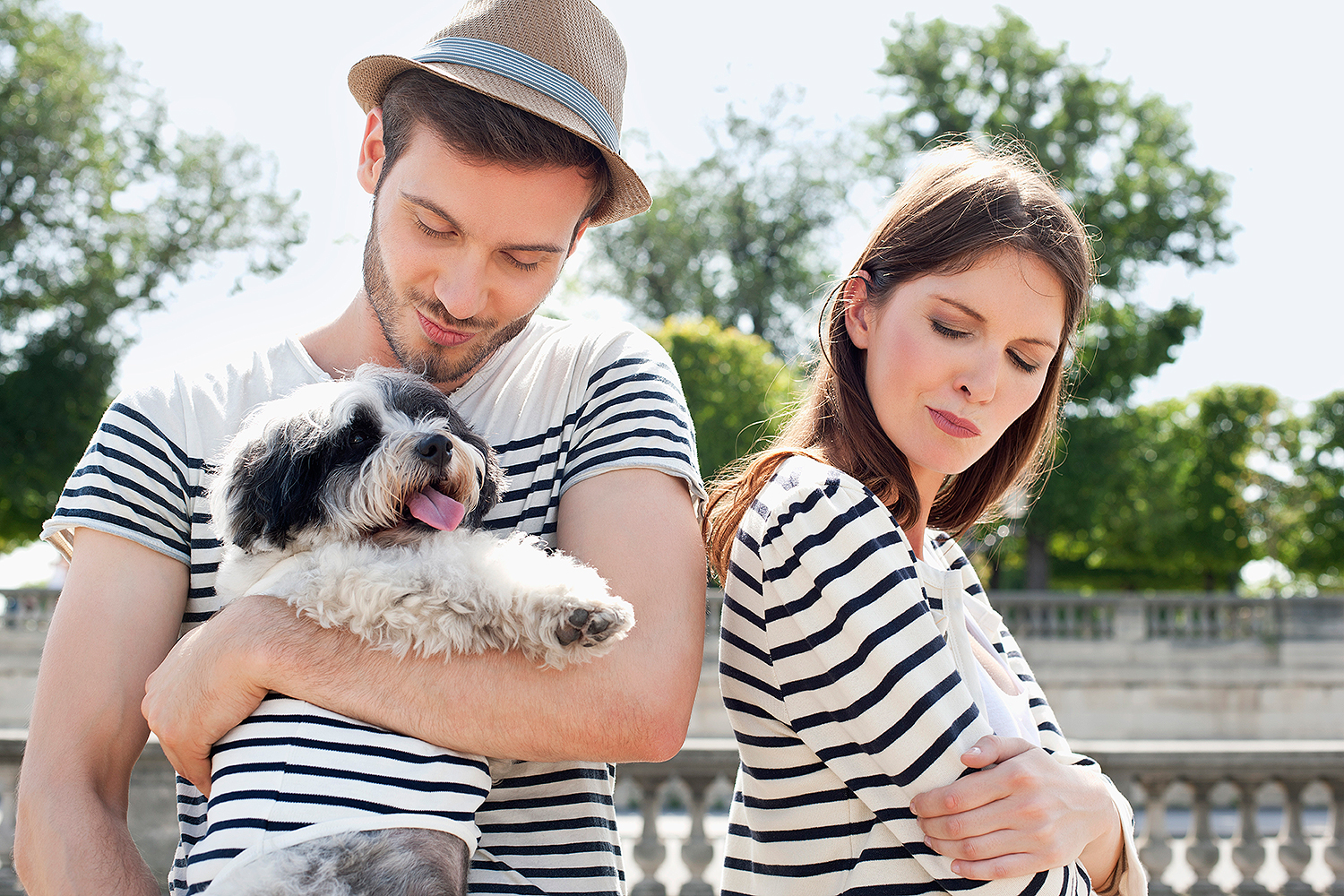 dog with unhappy couple