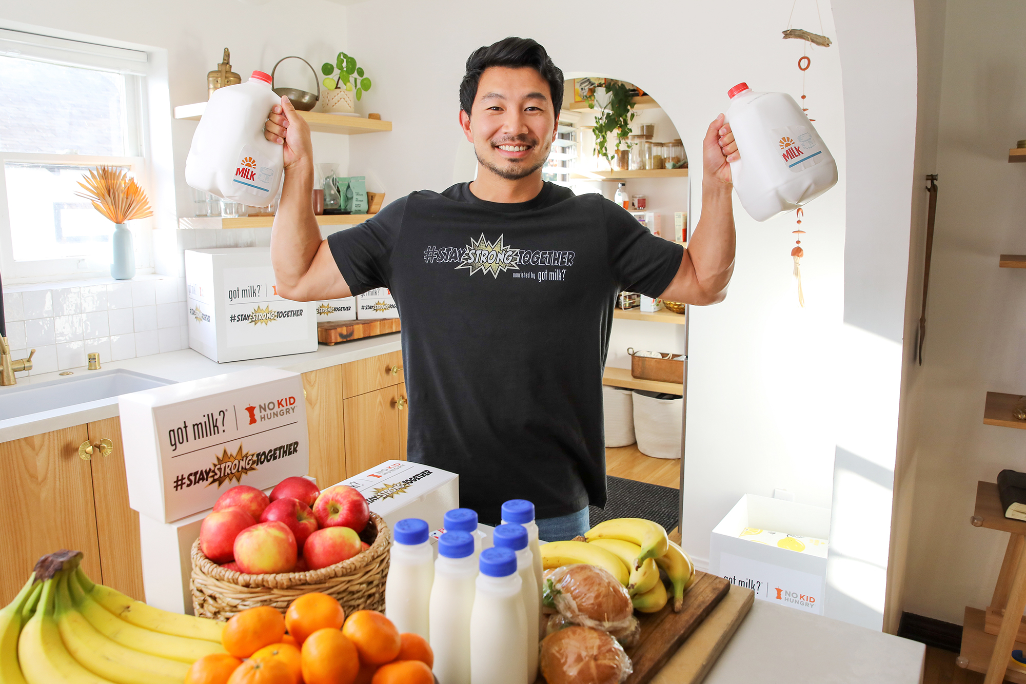 Marvel 'Shang Chi' Super Hero, Simu Liu, flexed his muscles alongside the creators of 'got milk?' during production for the #StayStrongTogether challenge