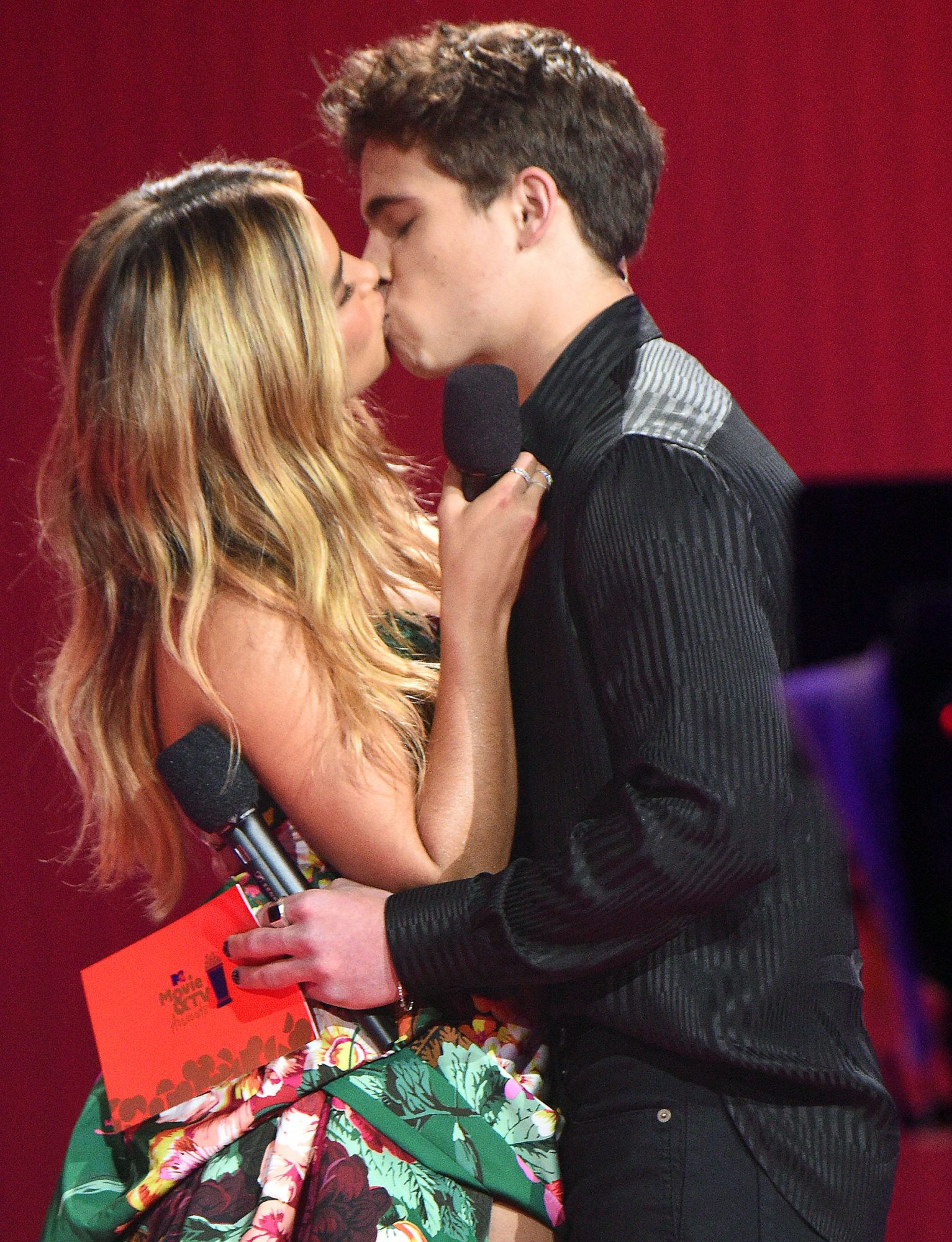 Addison Rae and Tanner Buchanan kiss onstage during the 2021 MTV Movie & TV Awards
