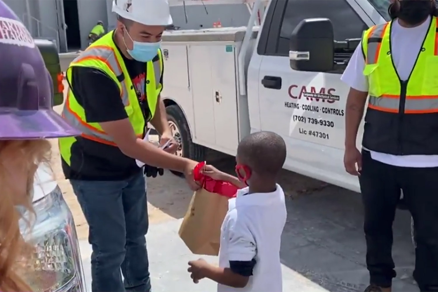 5-Year-Old Hands Out Goodie Bags to Community Workers