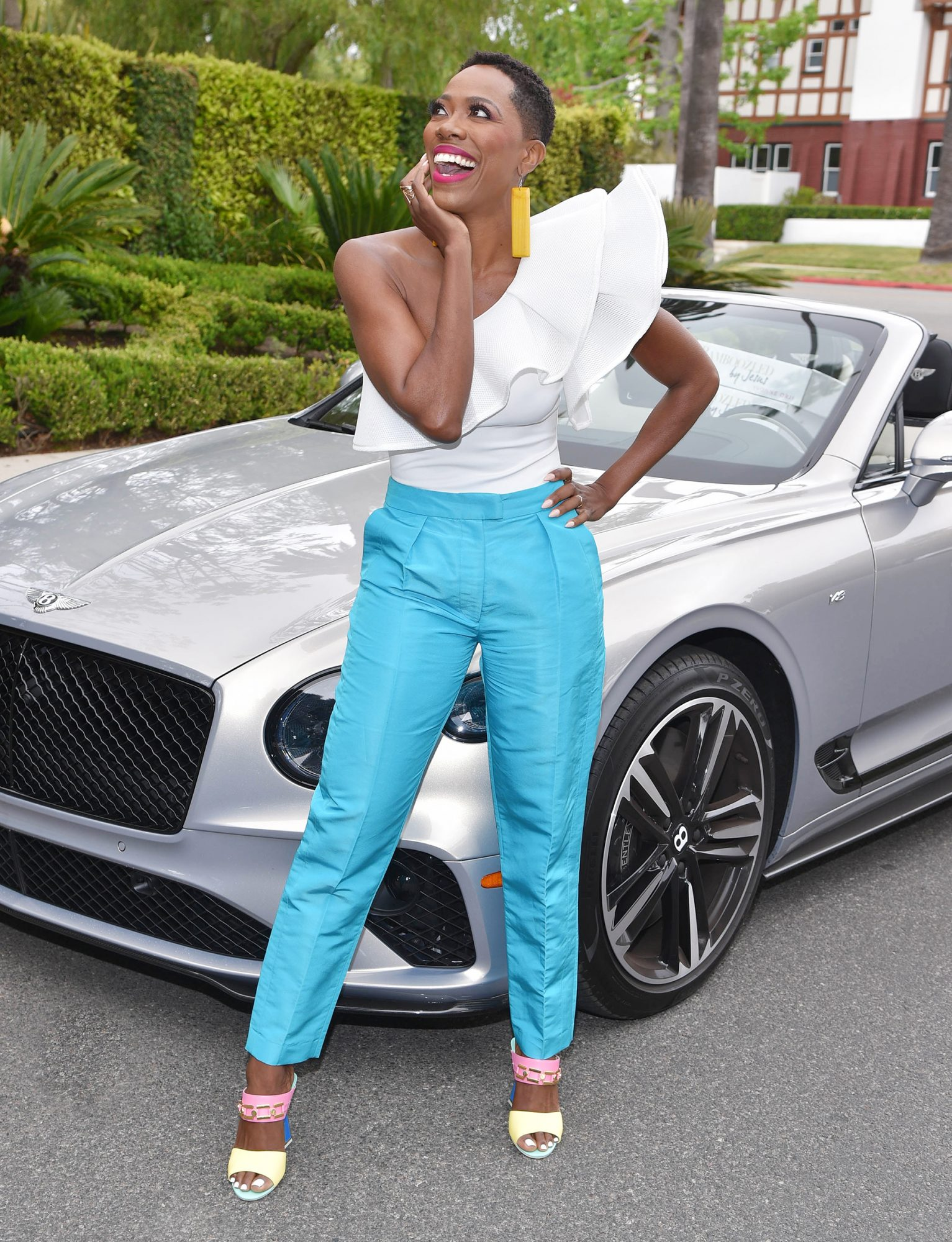 Yvonne Orji Delivers New Book Bamboozled by Jesus To Friends In Silver Bentley Continental GTC V8 Convertible