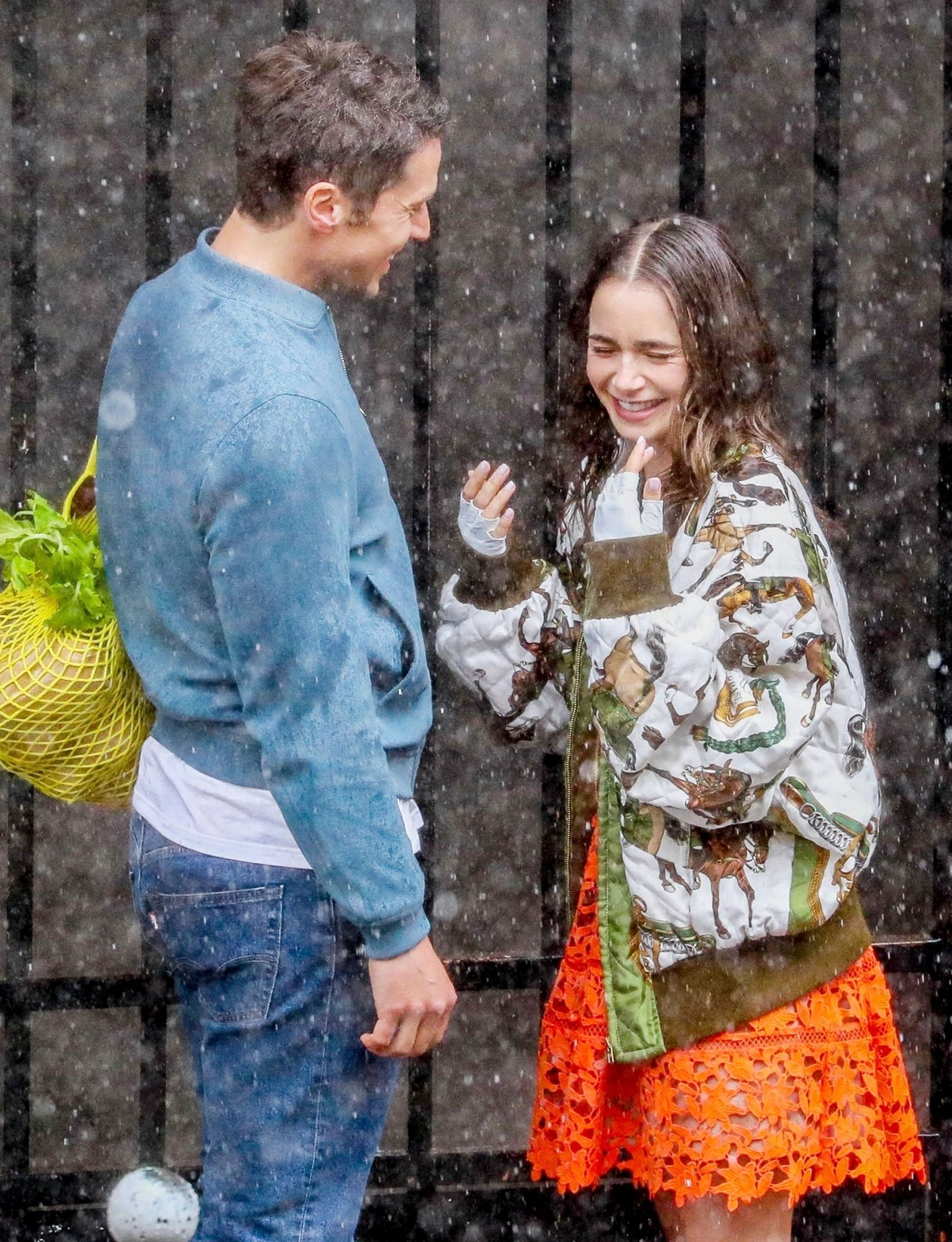 """Lily Collins and Lucas Bravo get caught in the rain on the set of """"Emily in Paris"""""""