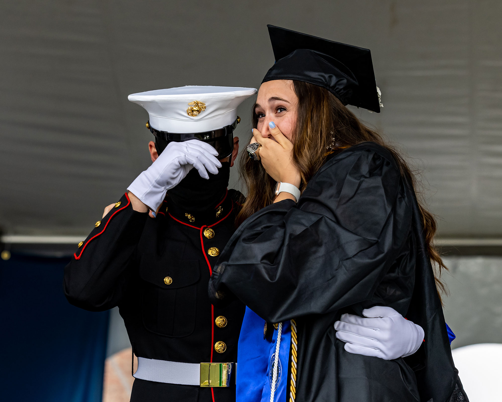 Graduating nursing student Emily Rose Booth of Stratford, CT, who received a B.S. in nursing, was surprised today on stage at Endicott College's commencement by her brother, U.S. Marine PFC Ryan Booth, whom she has not seen in one year.