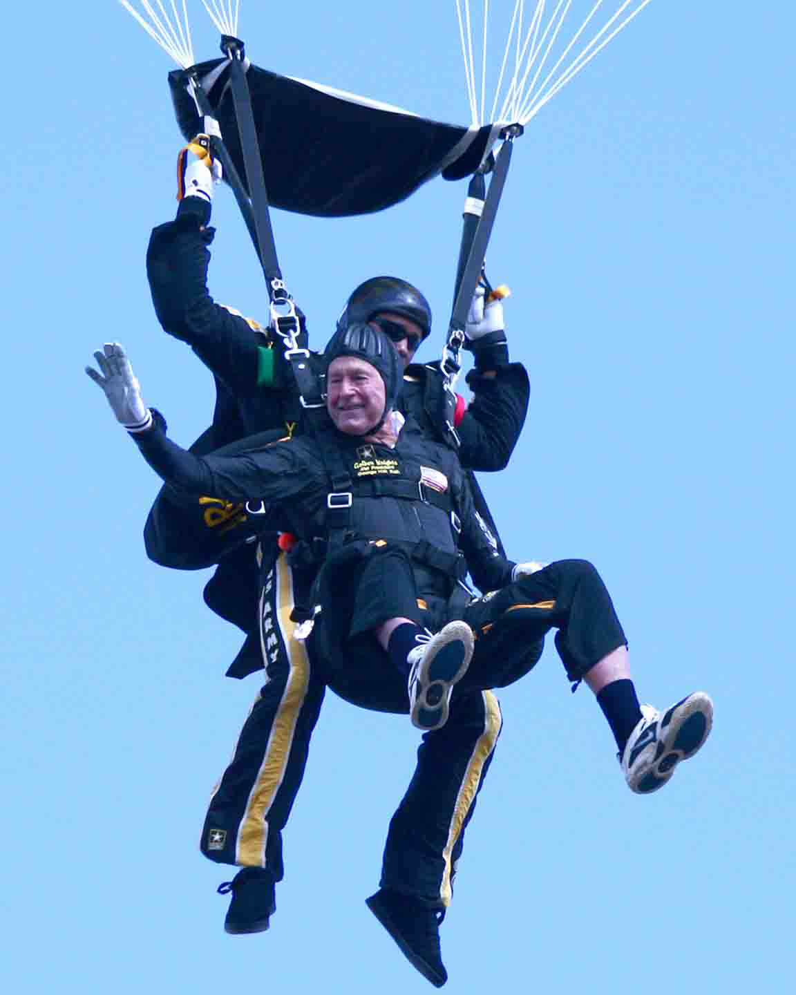 President Bush arrives by parachute for the 10th anniversary celebration of the opening of the George H.W. Bush Library.