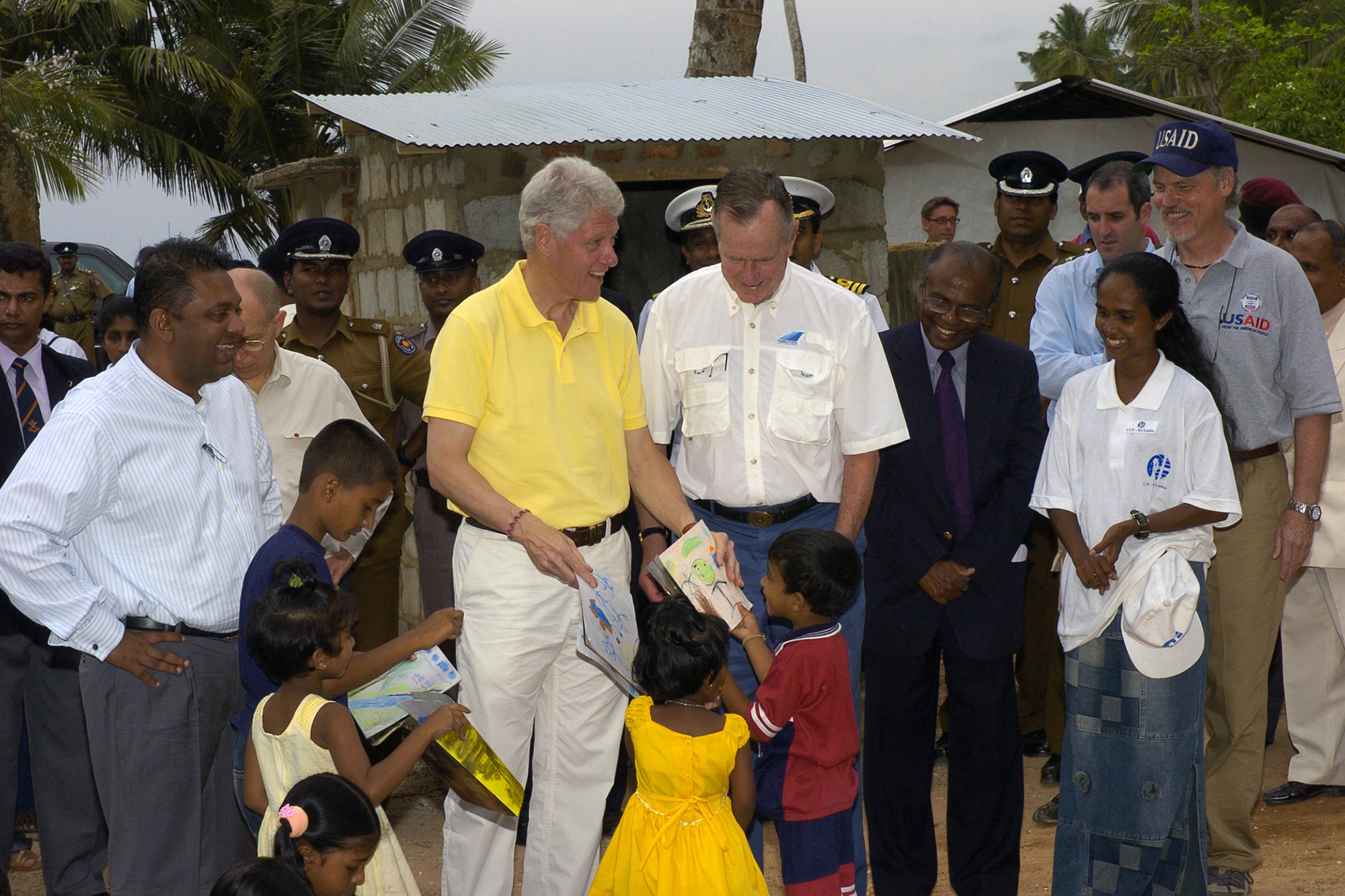 Presidents Bush and Clinton visit with children in Indonesia during their trip in February 2005 after the tsunami that ravaged large parts of Asia.