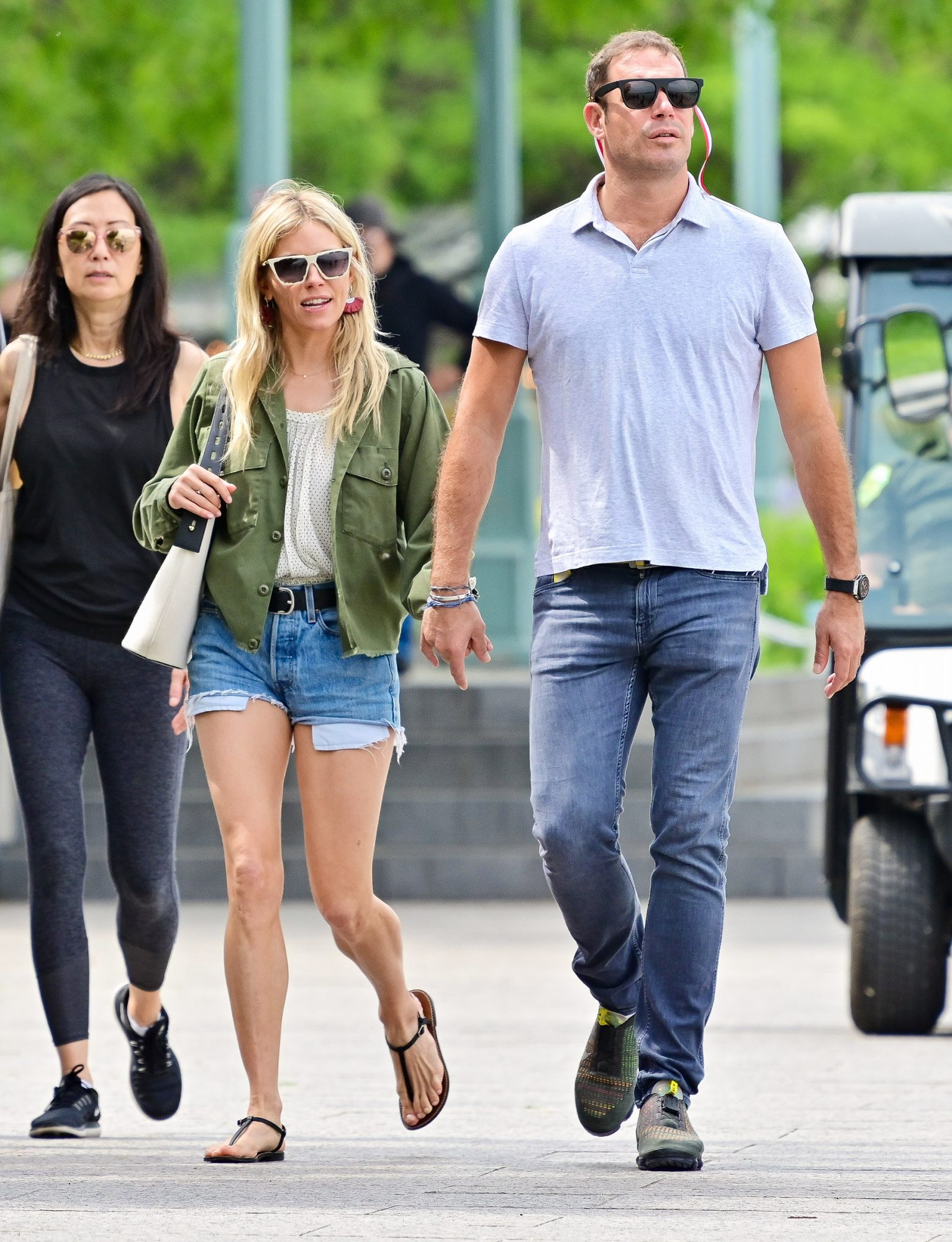 Sienna Miller and Archie Keswick hold hands in Hudson River Park on June 01, 2021 in New York City