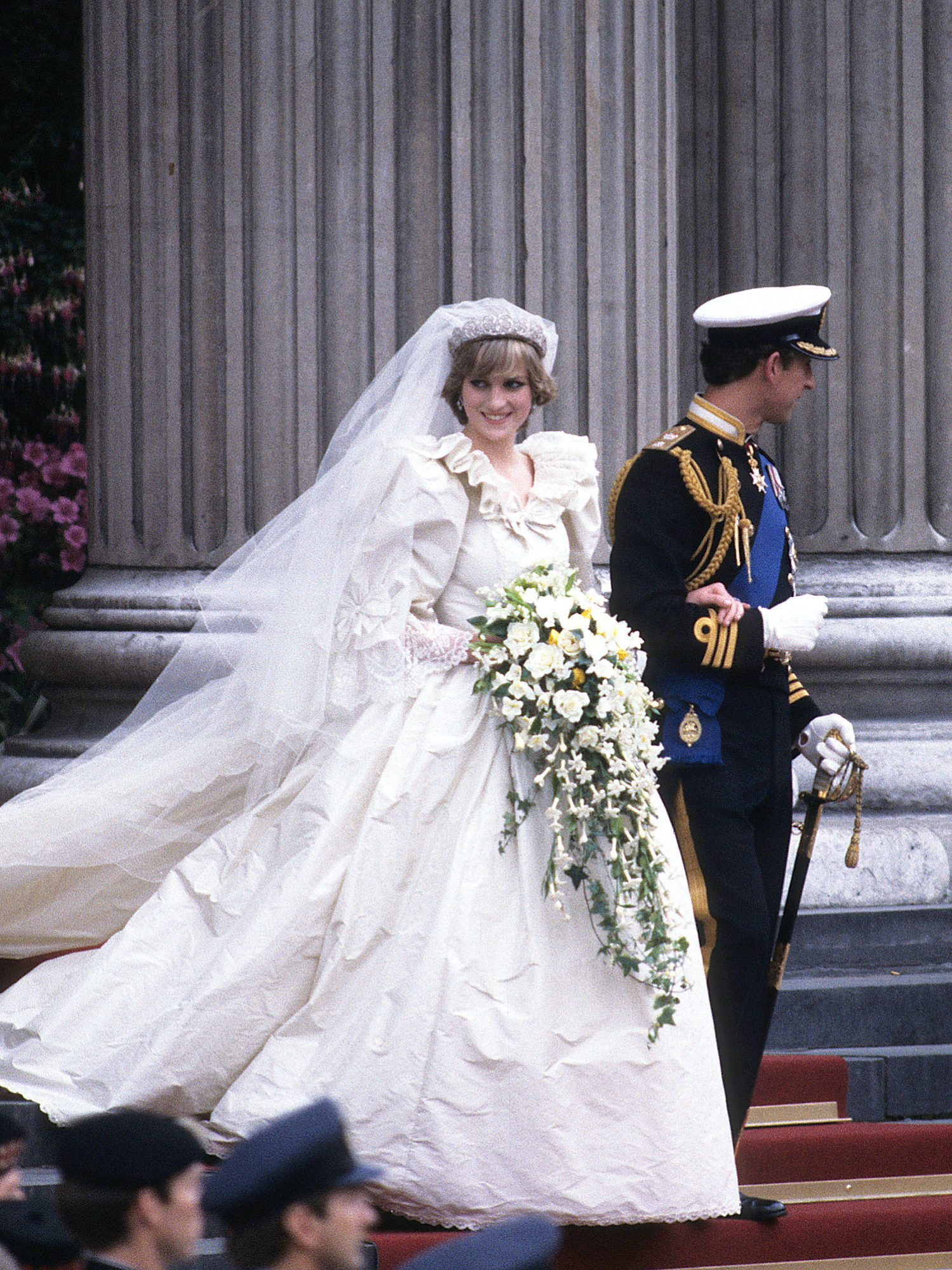 Prince Charles, Prince of Wales and Diana, Princess of Wales, wearing a wedding dress designed by David and Elizabeth Emanuel and the Spencer family Tiara, leave St. Paul's Cathedral