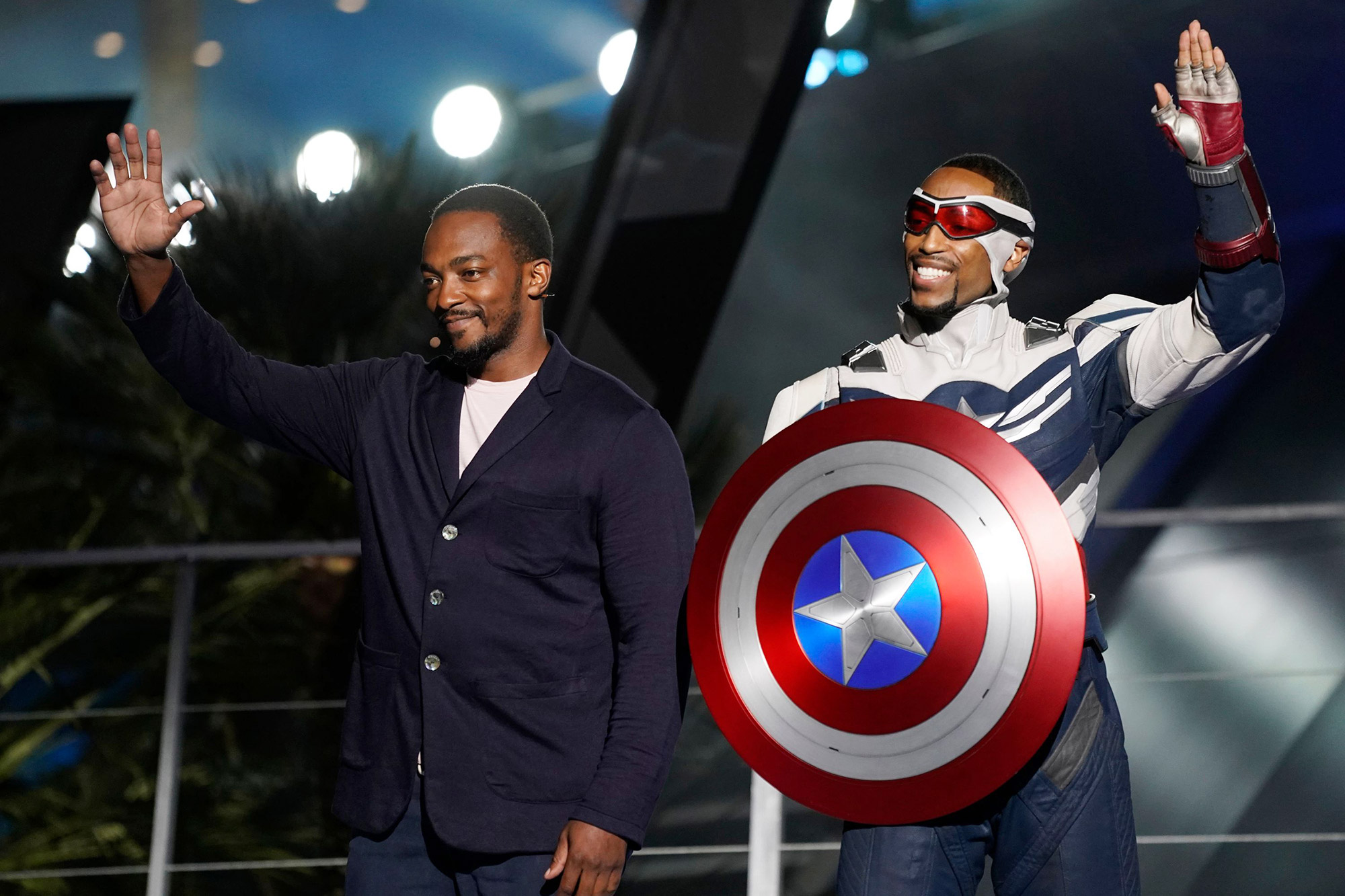 Anthony Mackie, left, and his character Captain America, right, appear on stage at the Avengers Campus dedication ceremony at Disney's California Adventure Park, in Anaheim, Calif