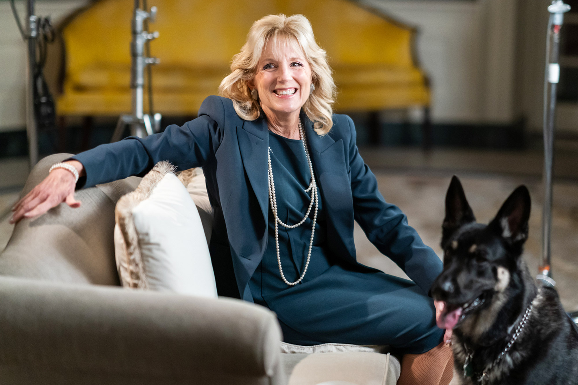 First Lady Dr. Jill Biden and the Biden family dog Major prepare to tape a video segment with President Joe Biden for Super Bowl LV Wednesday, Feb. 3, 2021, in the Diplomatic Reception Room of the White House.