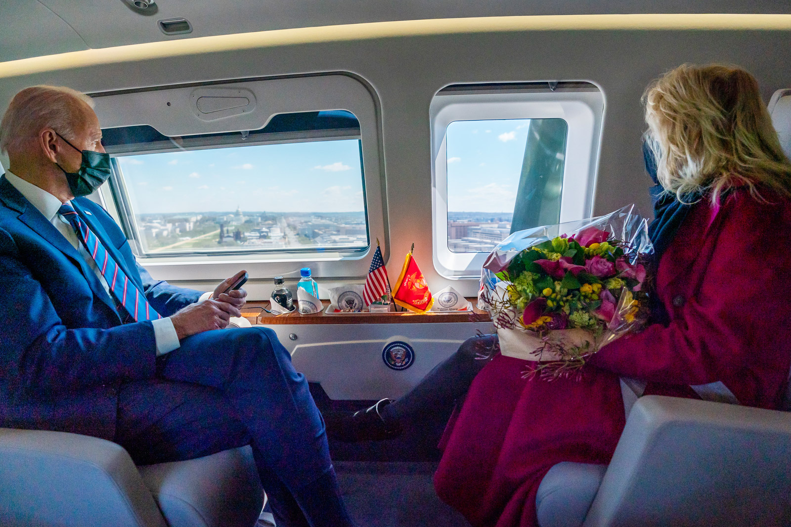 President Joe Biden and First Lady Jill Biden look out the windows of Marine One at they fly over the National Mall in Washington, D.C. on Friday, April 2, 2021, en route to Camp David, near Thurmont, Maryland
