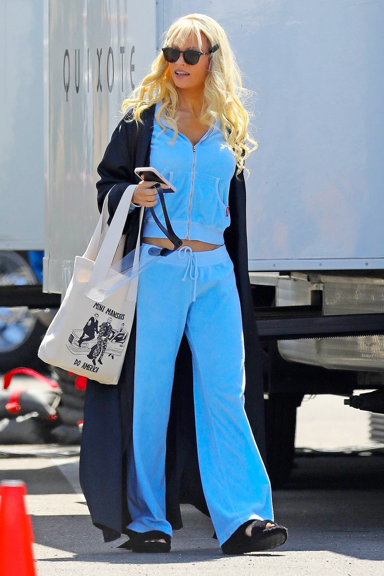 Lily James displays another one of Pamela Anderson's most memorable looks on set!