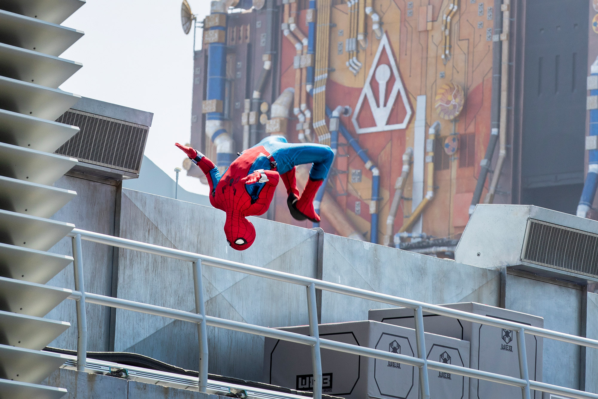Spider-Man does a back flip while performing at Web Slingers: A Spider-Man Adventure during media preview of Avengers Campus, California Adventure