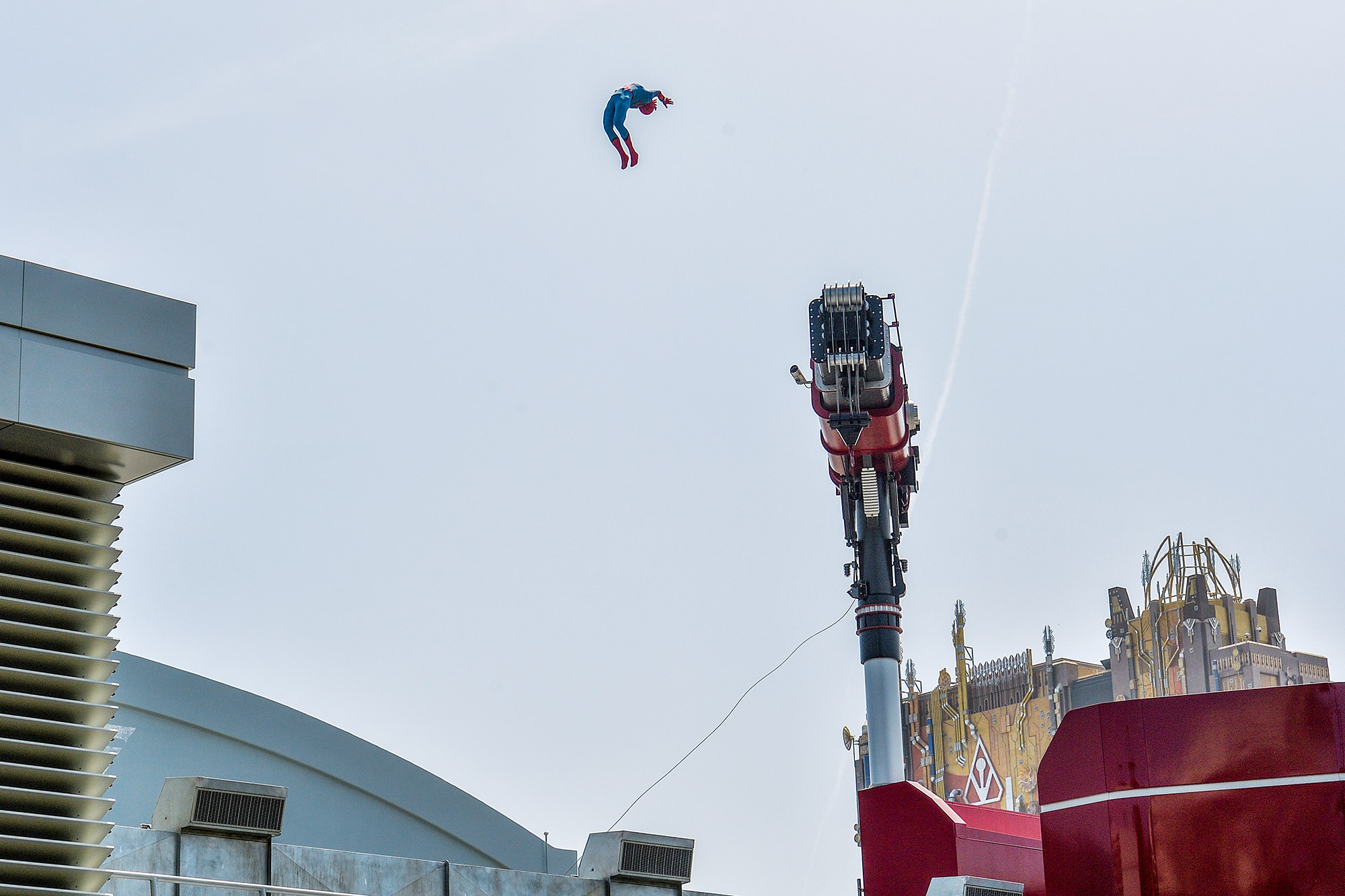 A stuntronic audio-animatronic Spider-Man is flung across the top of the Web Slingers: A Spider-Man Adventure attraction at Avengers Campus inside Disney California Adventure in Anaheim, CA, on Wednesday, June 2, 2021