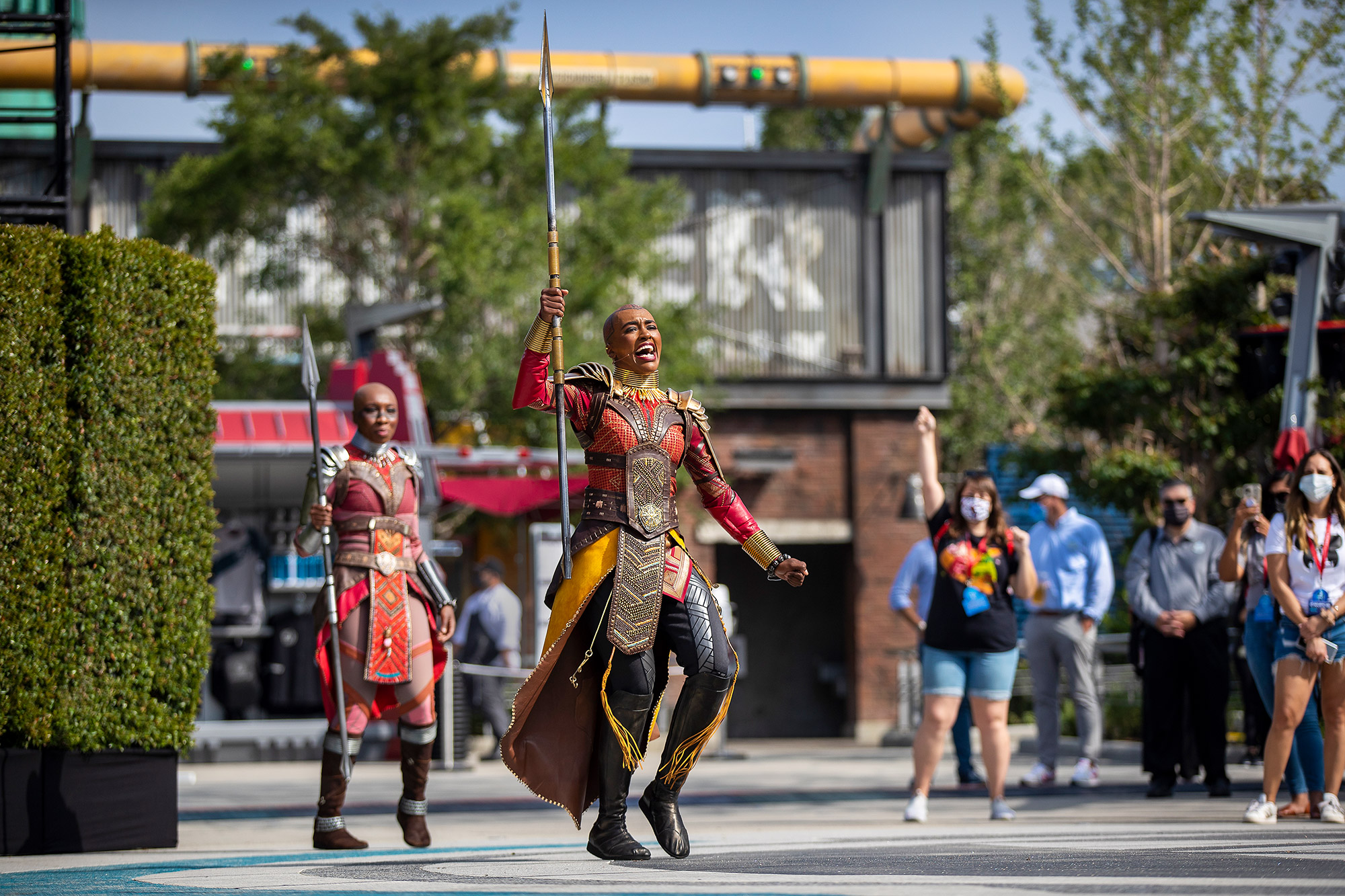 Spear-waving warriors known as Black Panthers Dora Milaje, Wakanda's elite fighting force and the country's royal guard, perform during a media preview of Avengers Campus at California Adventure on Wednesday, June 2, 2021 in Anaheim, CA