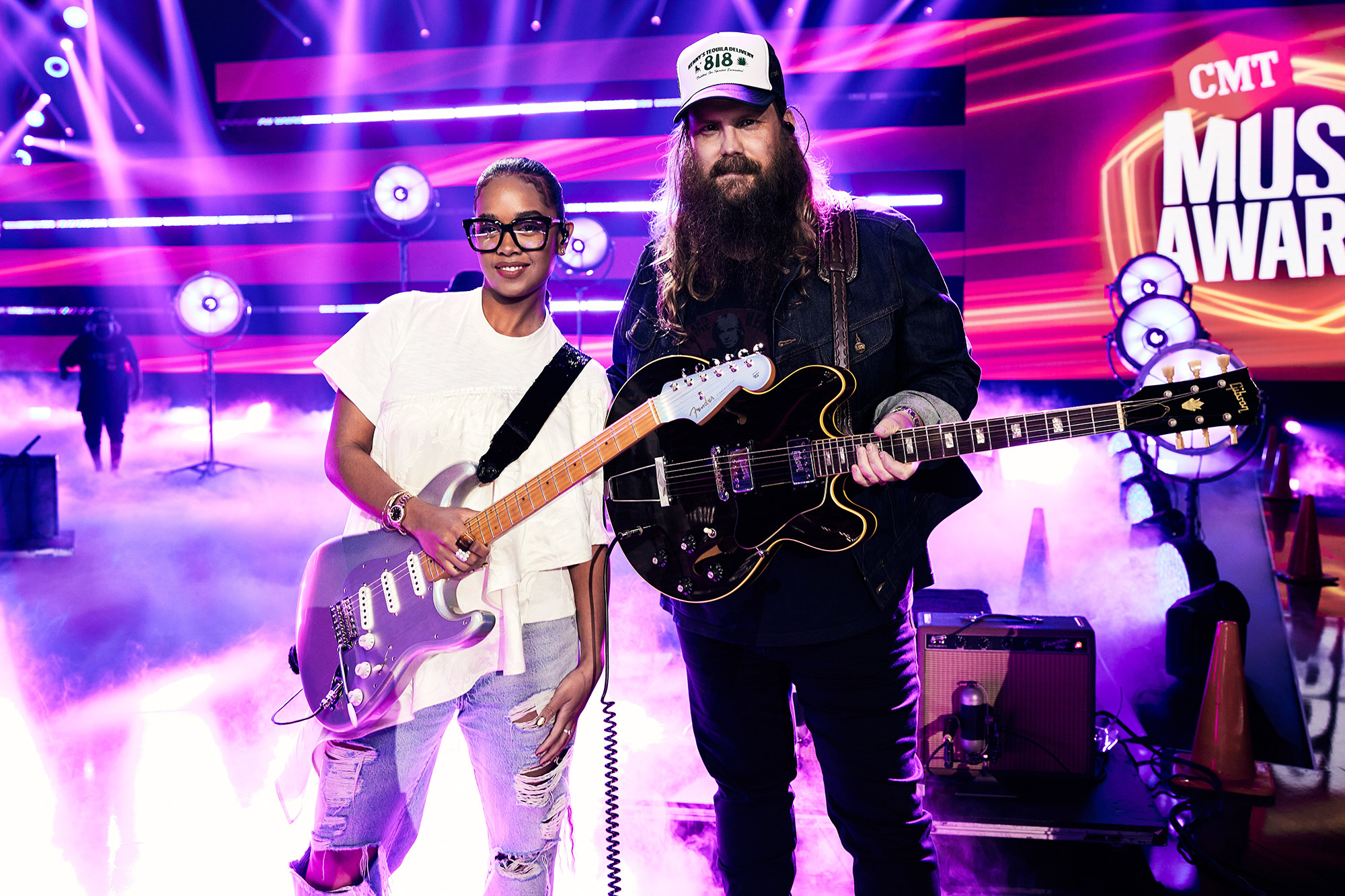 H.E.R. and Chris Stapleton posse during rehearsals for the 2021 CMT Music Awards on June 08, 2021 in Nashville, Tennessee