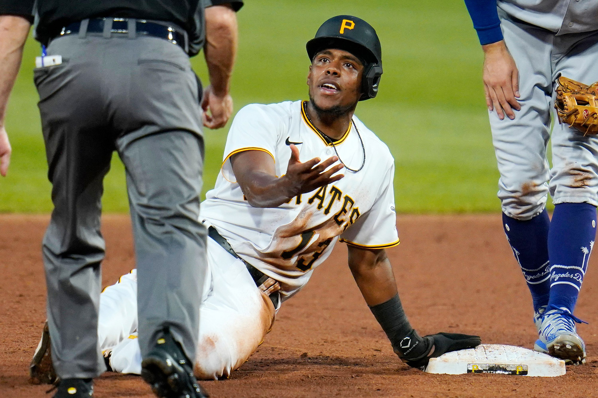 Pittsburgh Pirates' Ke'Bryan Hayes (13) appeals to umpire Dan Iassogna, left, after sliding past second base and being tagged out by Los Angeles Dodgers second baseman Chris Taylor during the third inning of a baseball game in Pittsburgh, . Hayes remained out and the inning ended Dodgers Pirates Baseball, Pittsburgh, United States - 08 Jun 2021