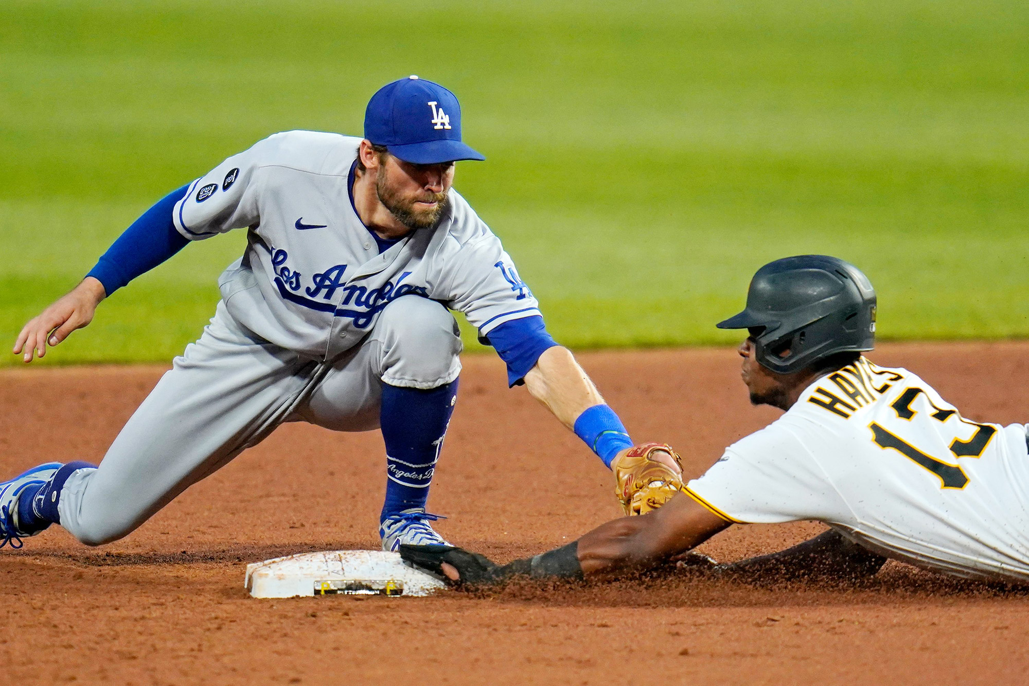 Los Angeles Dodgers second baseman Chris Taylor, left, puts the tag on Pittsburgh Pirates' Ke'Bryan Hayes (13) during the third inning of a baseball game in Pittsburgh, . Hayes slid past the bag, and was tagged out to end the inning Dodgers Pirates Baseball, Pittsburgh, United States - 08 Jun 2021