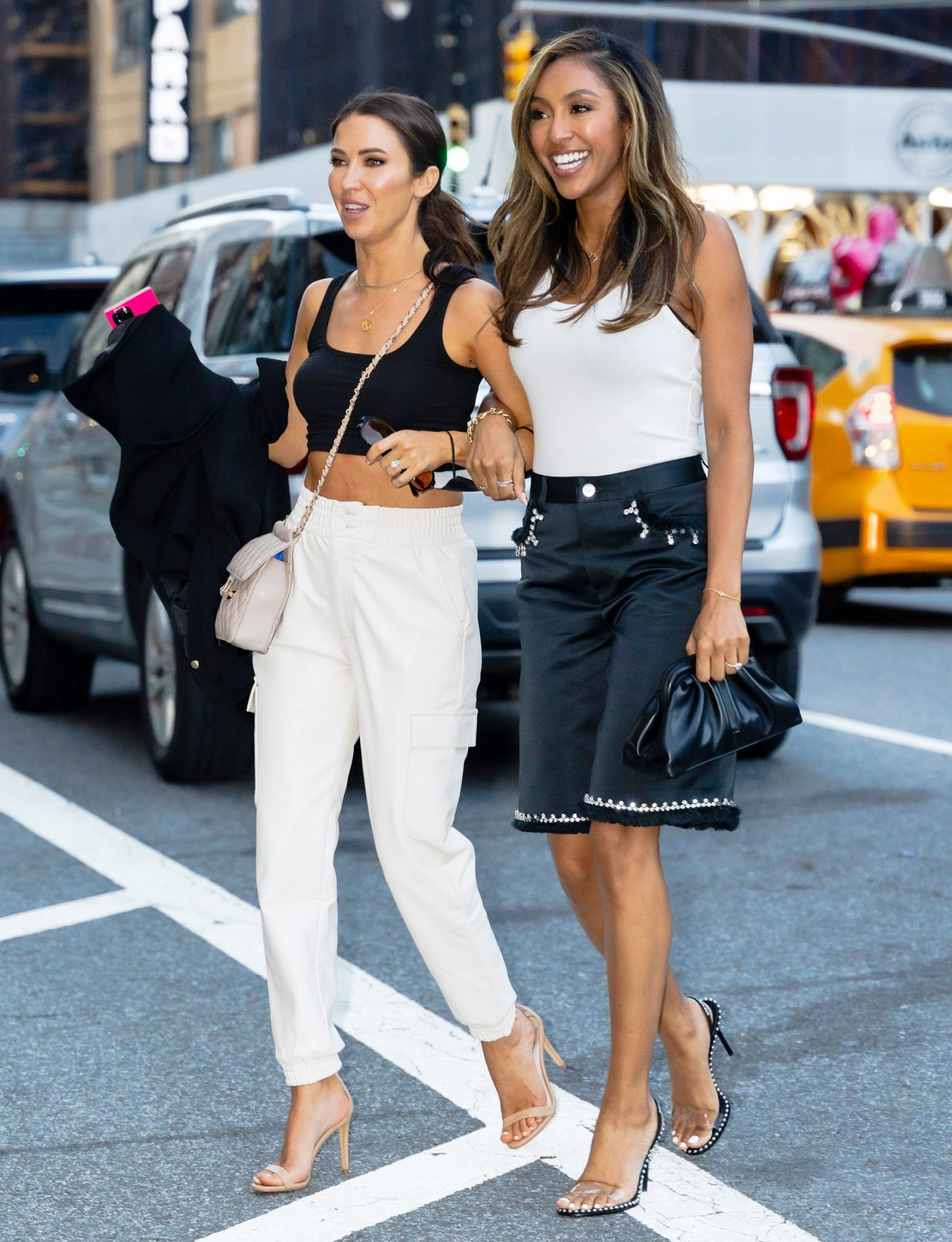 Kaitlyn Bristowe (L) and Tayshia Adams are seen in NoHo on June 10, 2021 in New York City