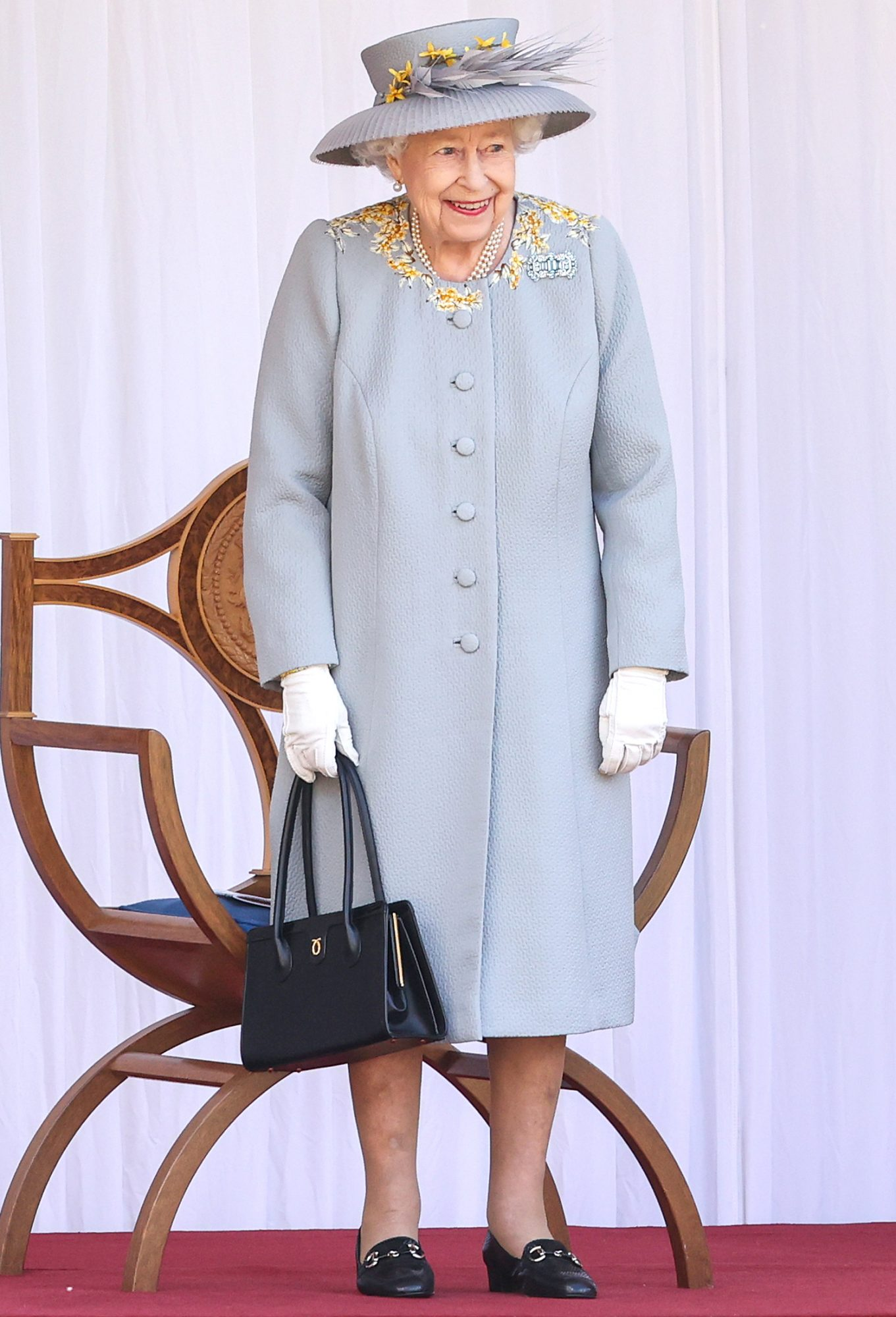 Queen Elizabeth II attends a military ceremony in the Quadrangle of Windsor Castle