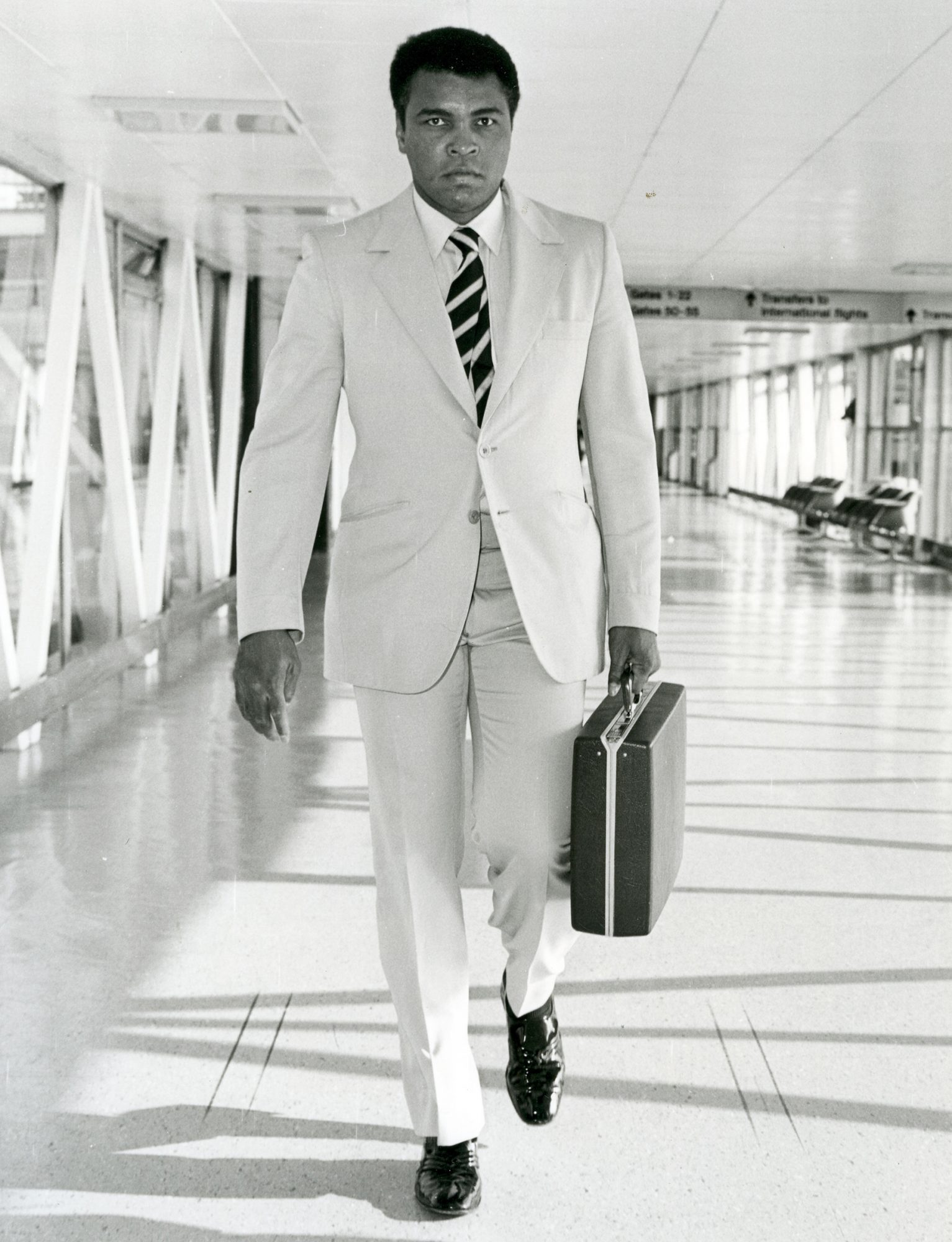 MUHAMMAD ALI (Casius Clay) American boxer arriving at Heathrow airport about 1967