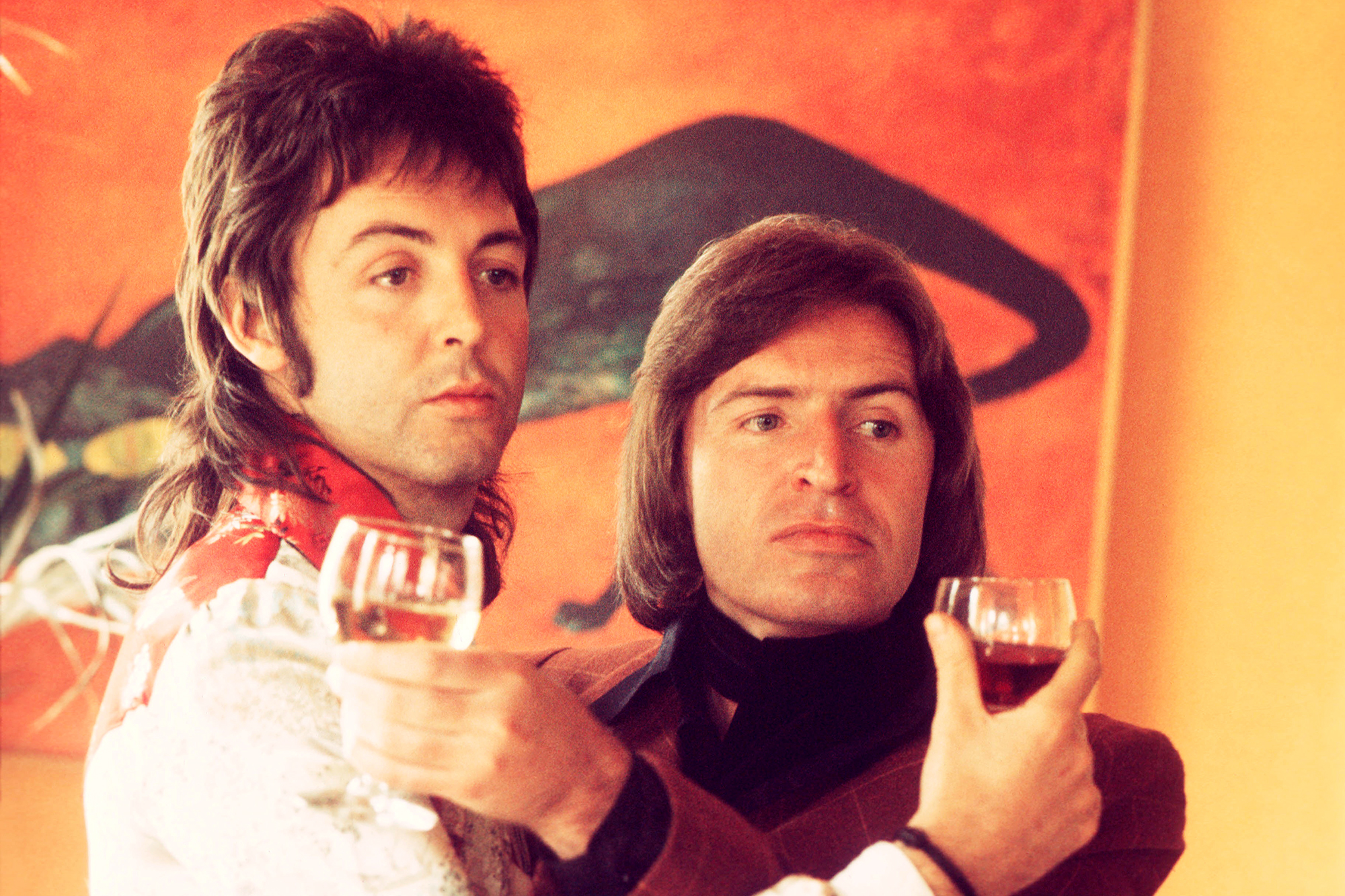 Paul McCartney during Wings era with his brother Mike McGear, portrait, London, 1974
