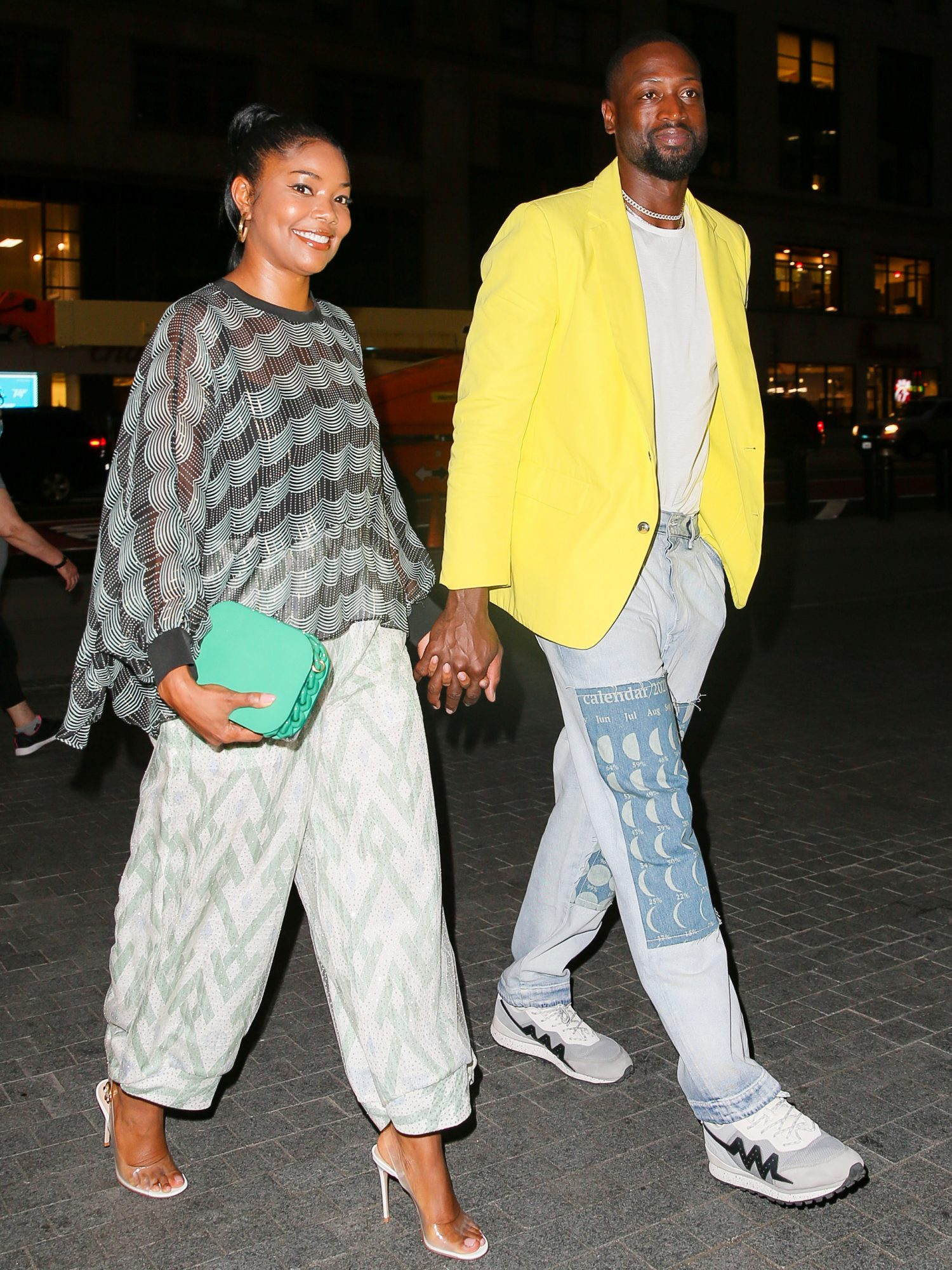 Gabrielle Union and Dwyane Wade are all smiling while arriving at Le Pavillon for a romantic dinner in NYC, Gabrielle was wearing Giorgio Armani and Dwyane wore a yellow blazer