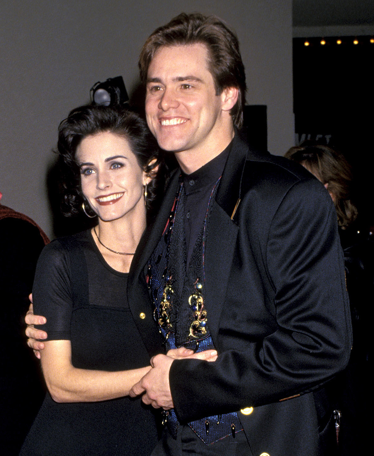 """Courteney Cox and Jim Carrey during Premiere of """"Ace Ventura: Pet Detective"""" at Mann's Bruin Theater in Westwood, California, United States."""