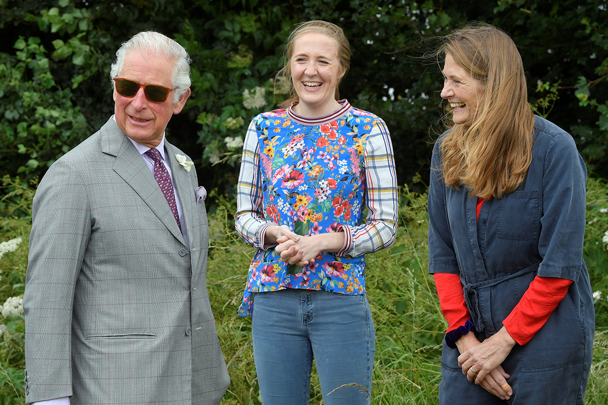 Britain's Prince Charles, Prince of Wales reacts as he speaks with beekeepers Tanya Hawkes and her daughter Esme during a tour of FarmED, a new center for farm and food education in Oxfordshire on June 22, 2021 in Chipping Norton, England. FarmED provides learning spaces and events that inspire, educate, and connect people to build sustainable farming and food systems.