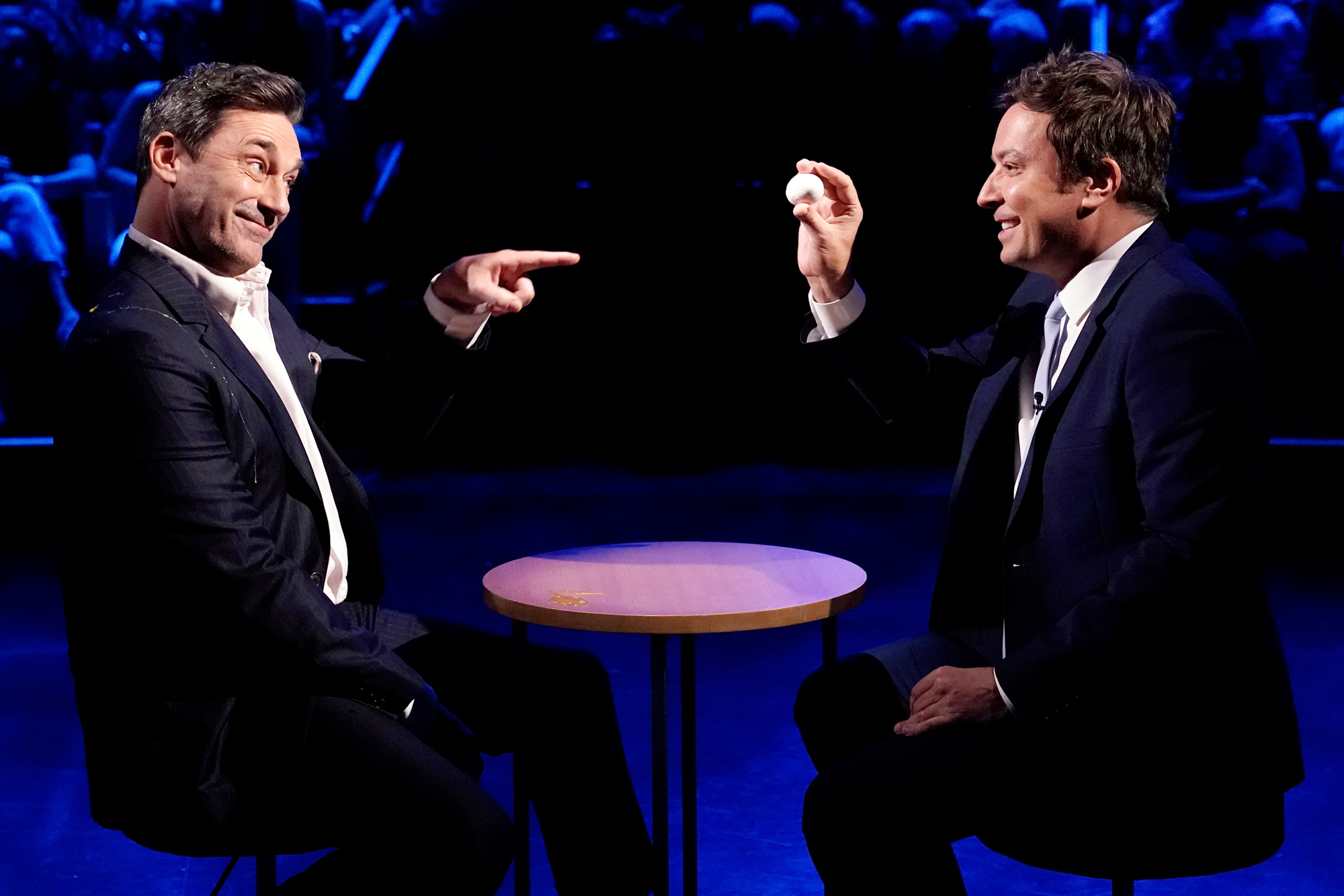 """THE TONIGHT SHOW STARRING JIMMY FALLON -- Episode 1486 -- Pictured: (l-r) Actor Jon Hamm and host Jimmy Fallon during """"Egg Russian Roulette"""" on Thursday, June 24, 2021"""