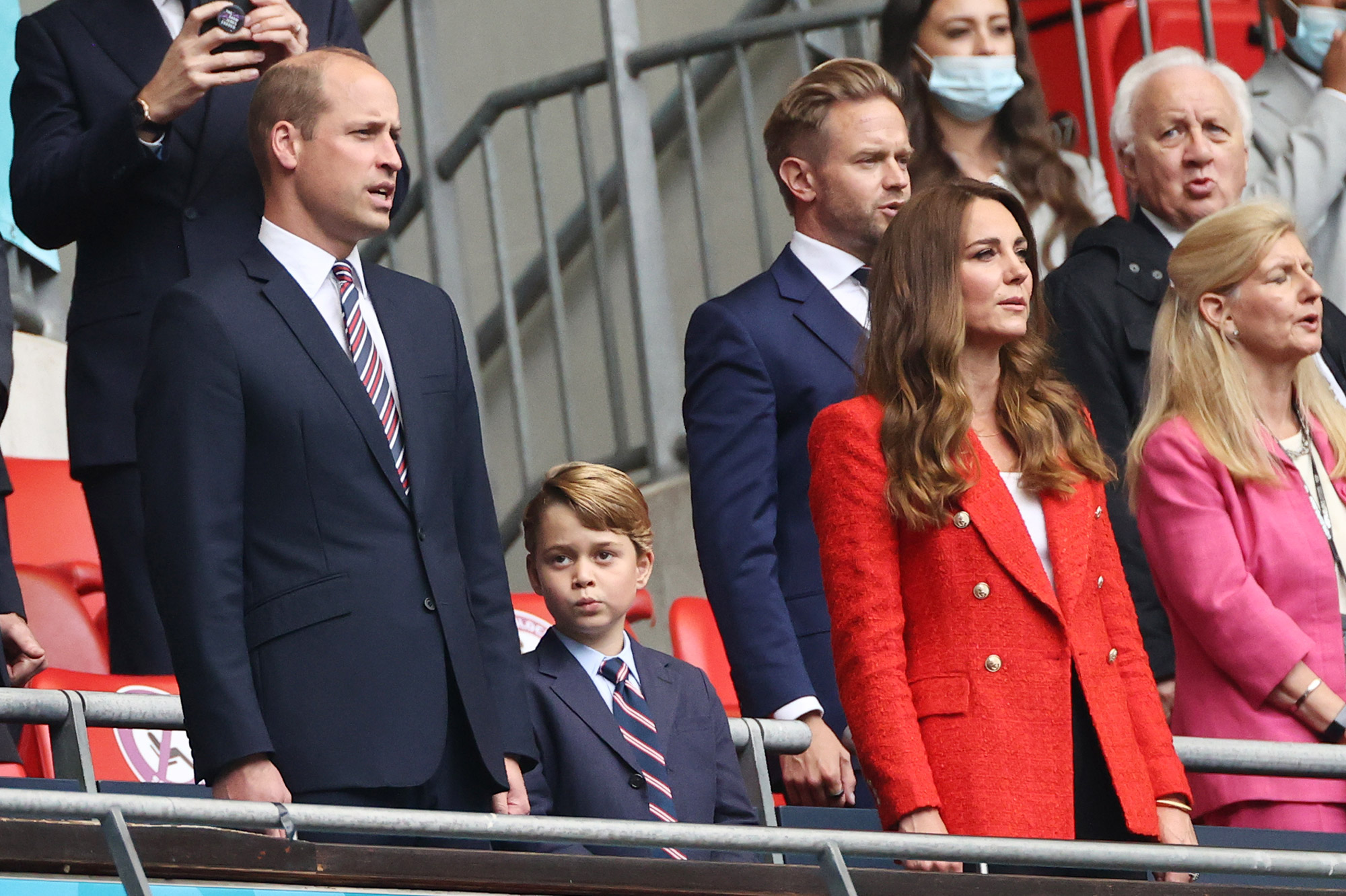 The British Prince William, Duke of Cambridge stands with his wife Kate, Duchess of Cambridge, and their son Prince George in the stands