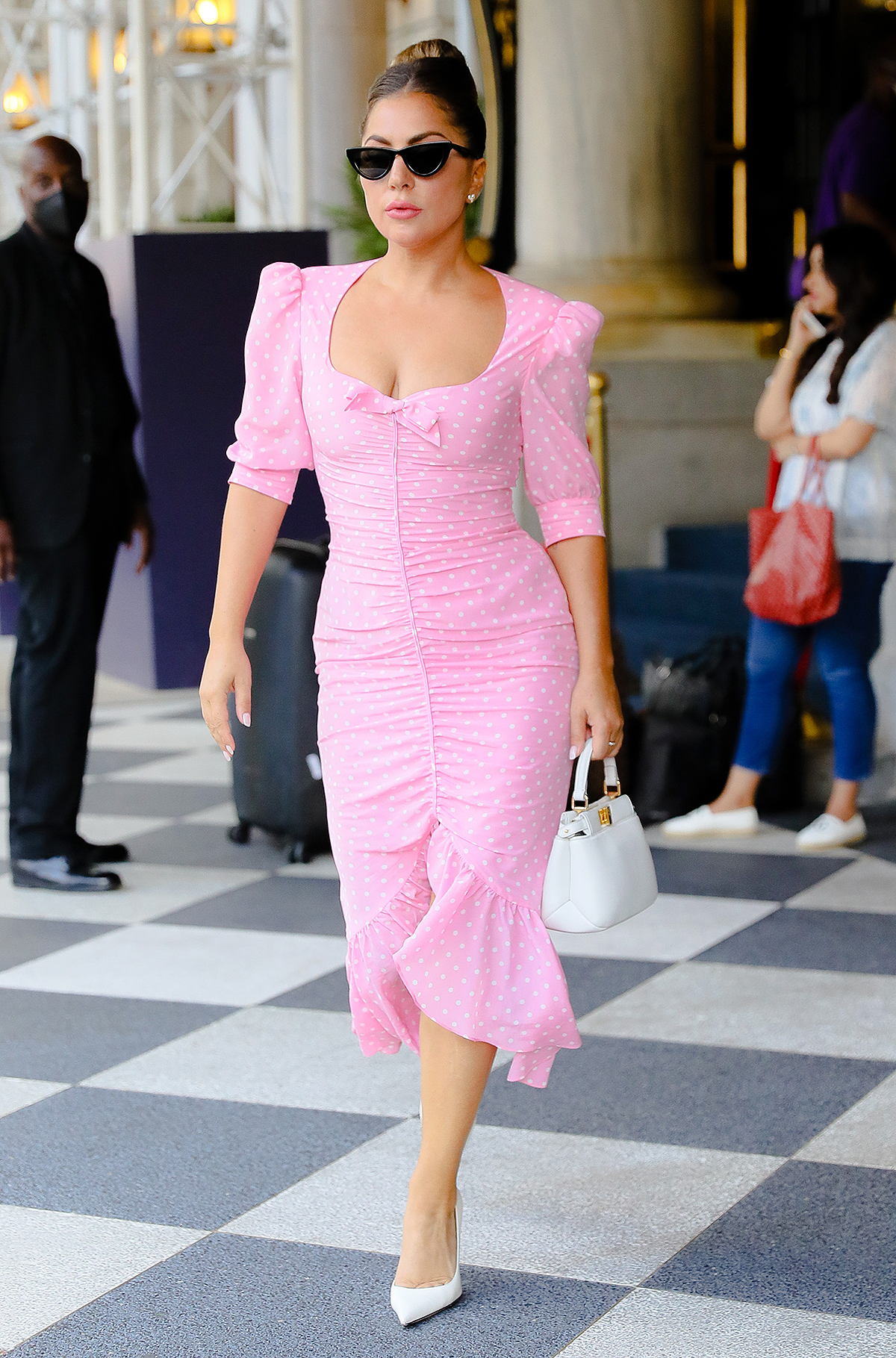 Style icon Lady Gaga looks fabulous in a Alessandra Rich pink polka dot dress as she steps out in New York City.