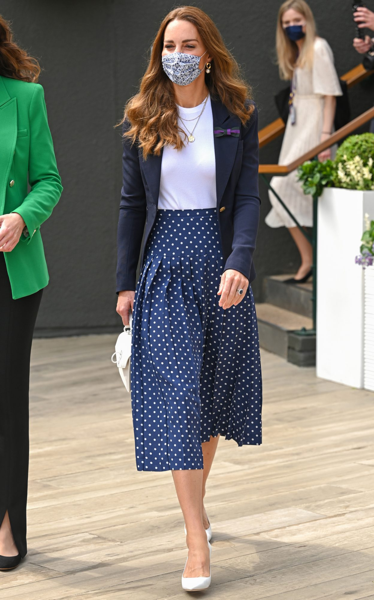 The Duchess of Cambridge (centre) attends day five of Wimbledon