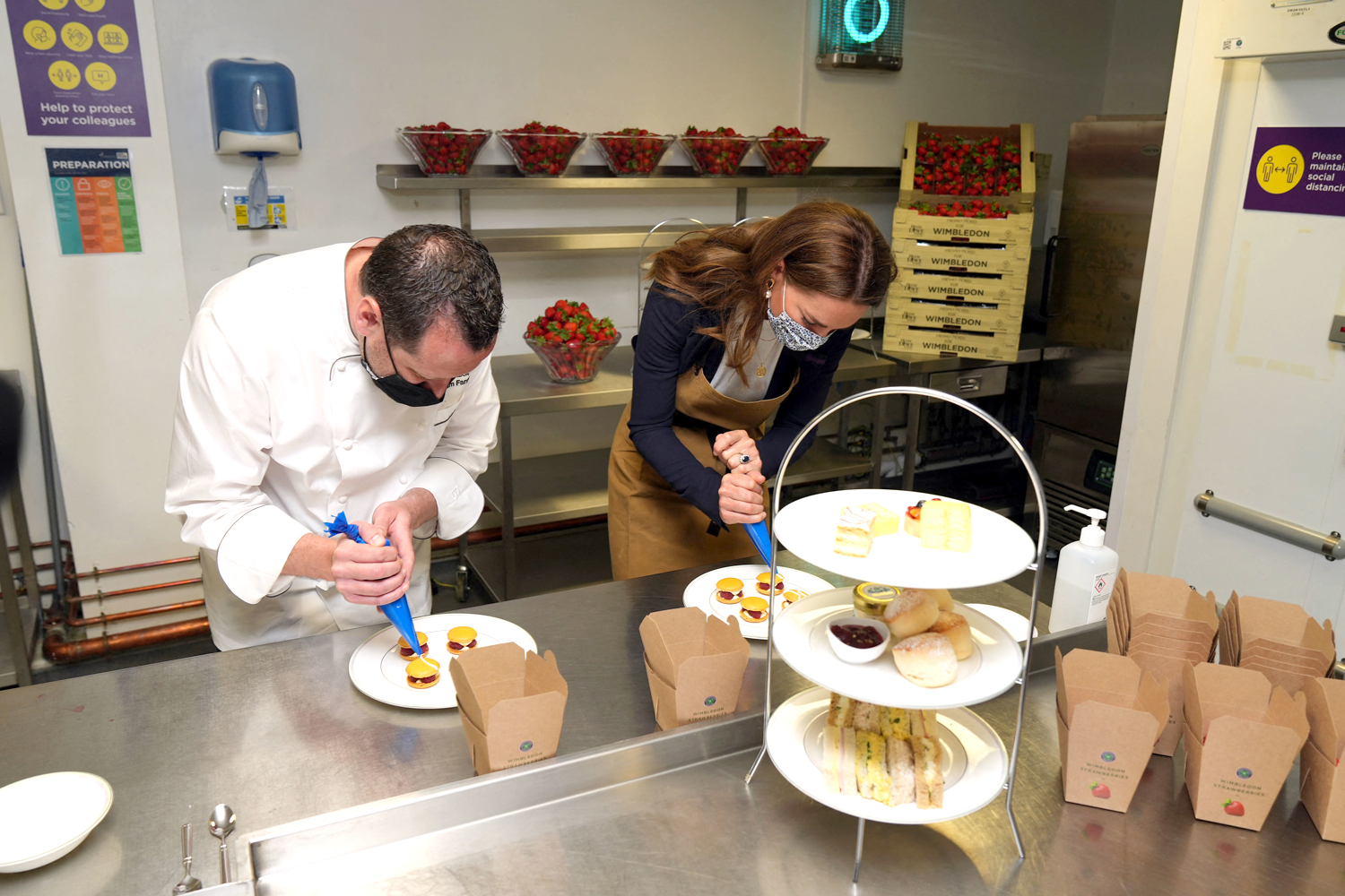 Catherine, Duchess of Cambridge, Patron of the All England Lawn Tennis Club, talks with with chef Adam Fargin