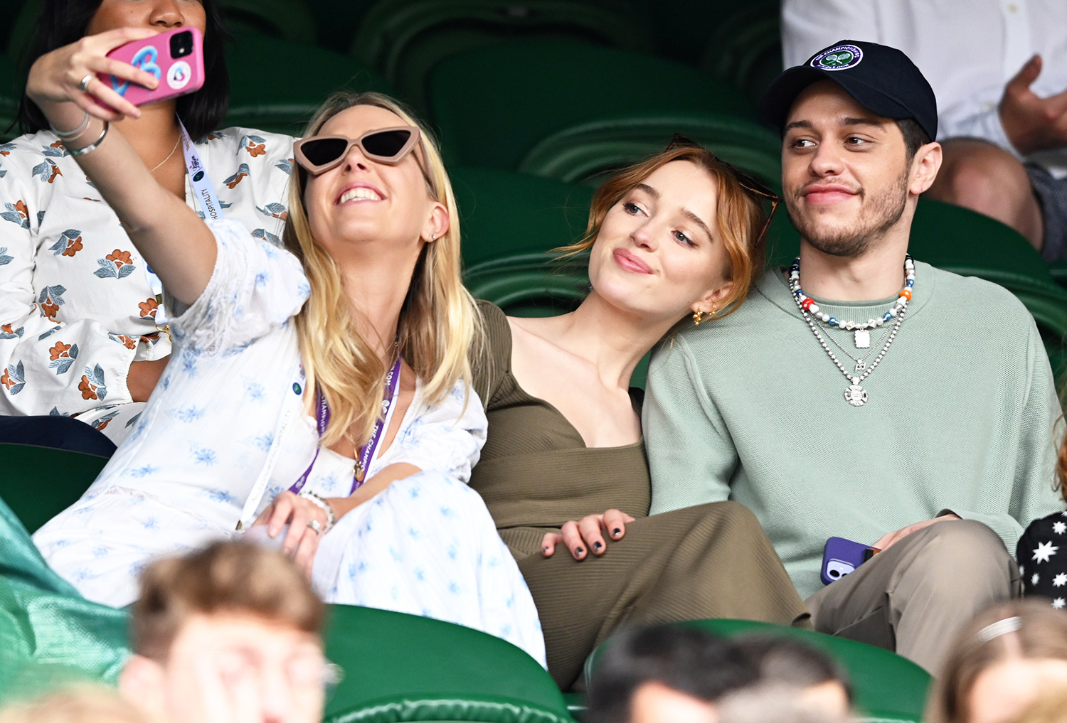 Phoebe Dynevor and Pete Davidson attend day 6 of the Wimbledon Tennis Championships at the All England Lawn Tennis and Croquet Club on July 03, 2021 in London, England.