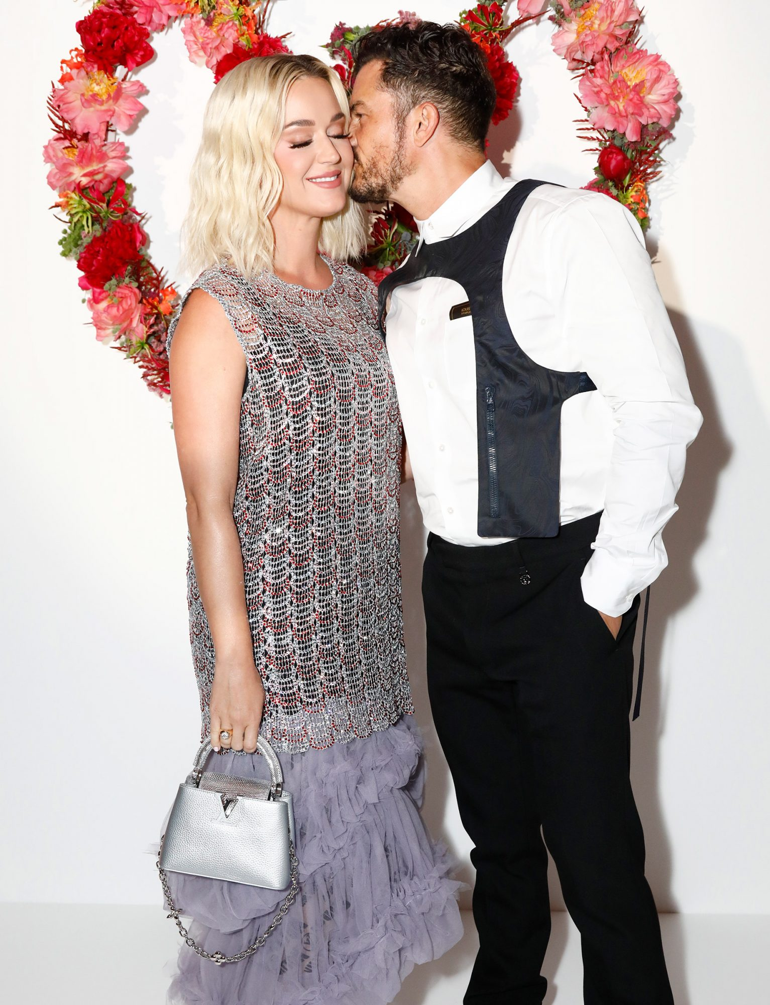 Katy Perry and Orlando Bloom attend the Louis Vuitton Parfum Dinner at Fondation Louis Vuitton at Fondation Louis Vuitton on July 05, 2021 in Paris, France