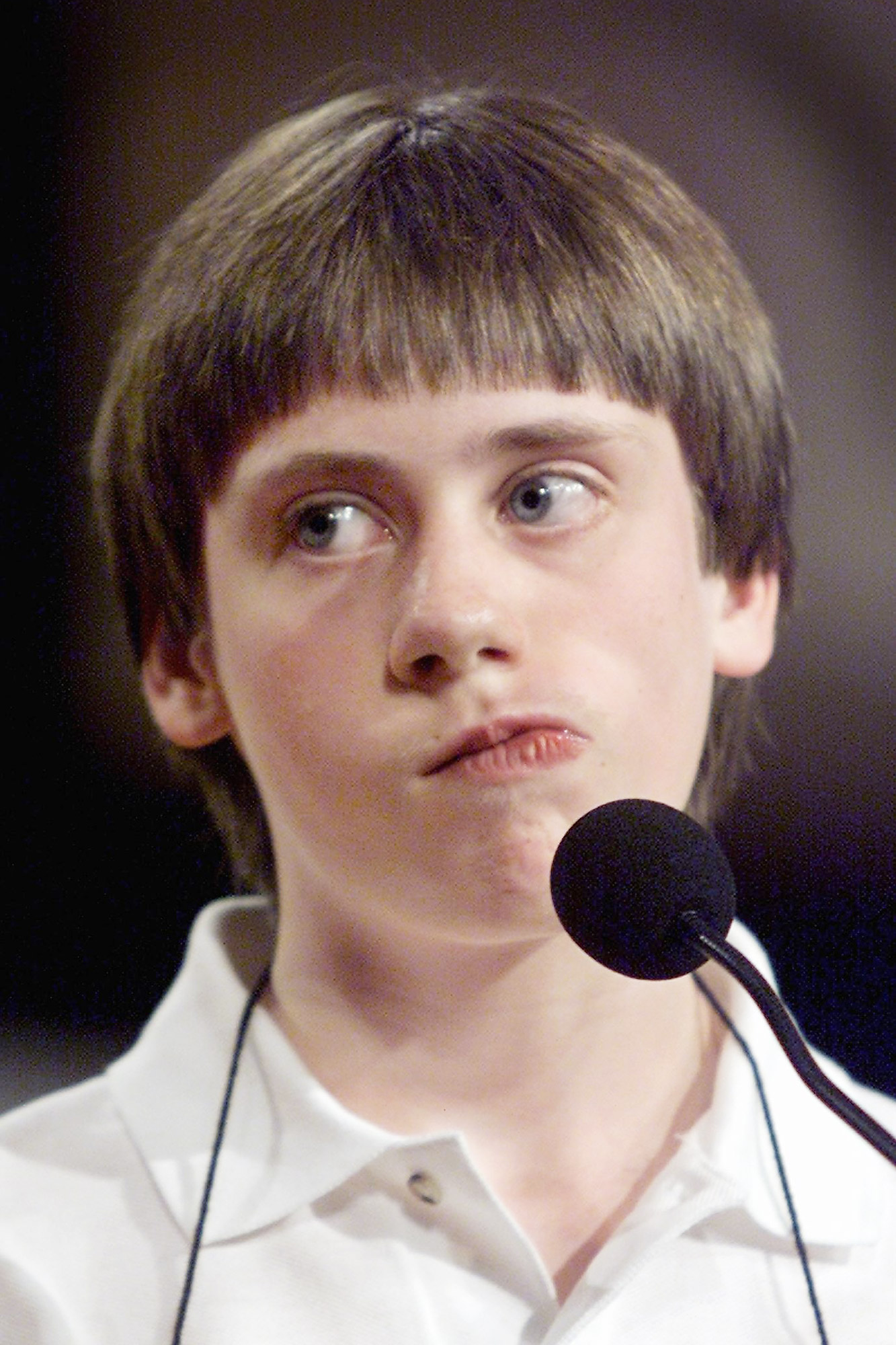 Sean Conley, 12, a seventh grader from the San Francisco, California community of Newark, reacts during the 73rd Annual Scripps Howard National Spelling Bee at the Grand Hyatt Hotel in Washington, DC, 01 June 2000