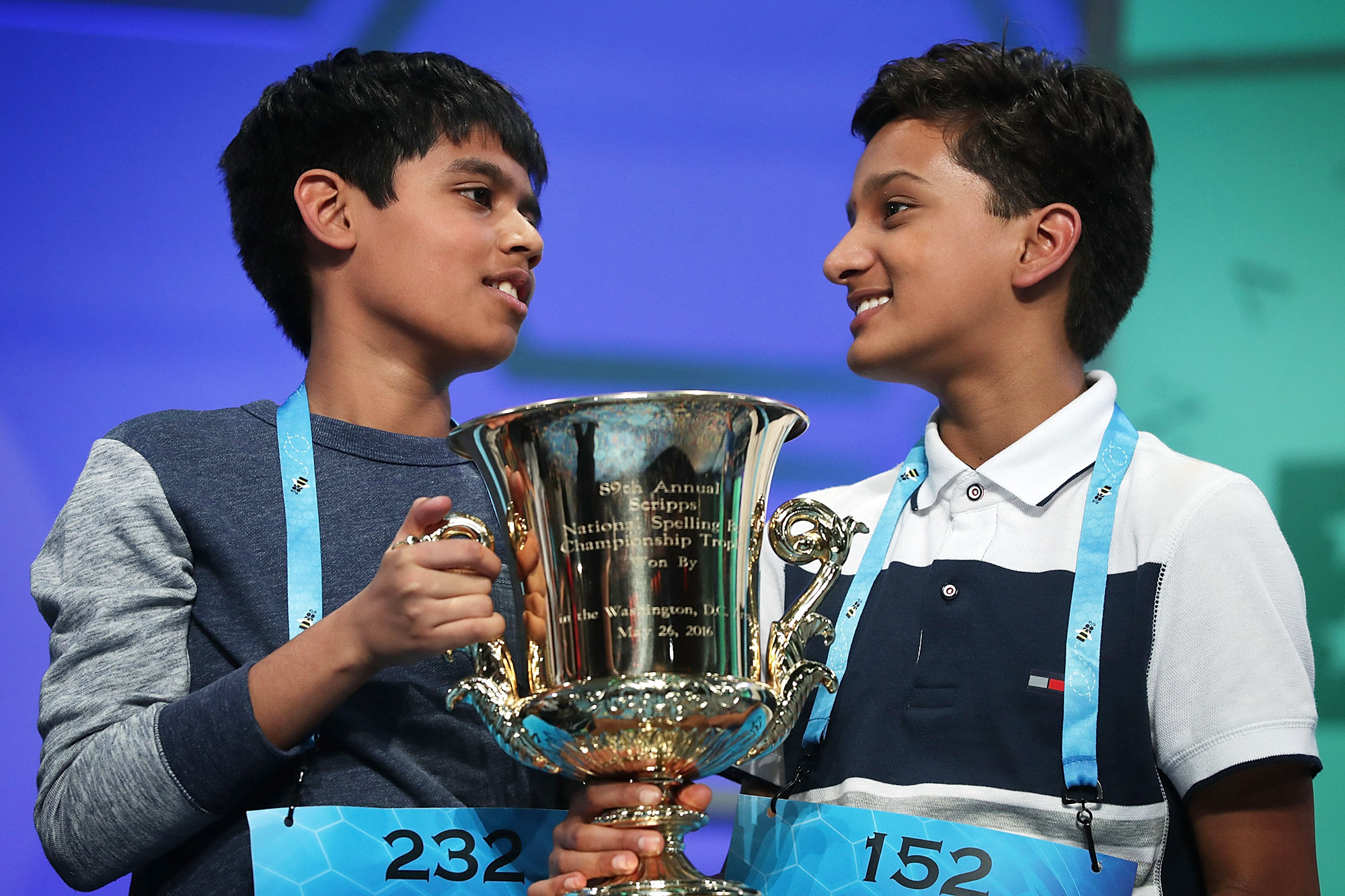 Spellers Nihar Saireddy Janga (L) of Austin, Texas and Jairam Jagadeesh Hathwar (R) of Painted Post, New York hold a trophy after the finals of the 2016 Scripps National Spelling Bee May 26, 2016 in National Harbor, Maryland