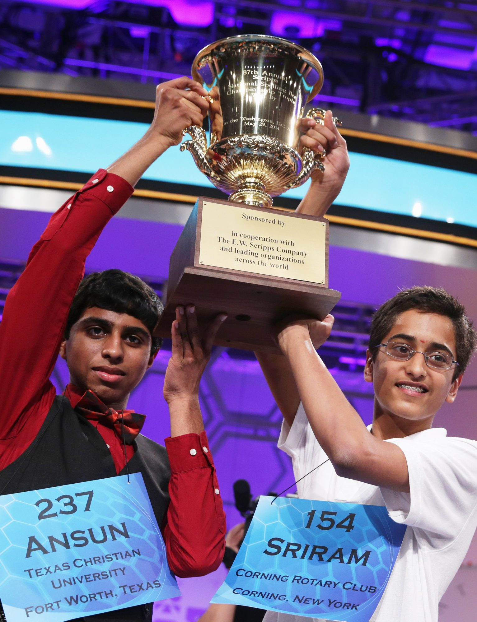 Sriram Hathwar (R) of Painted Post, New York and Ansun Sujoe (L) of Fort Worth, Texas hold their trophy at the end of the 2014 Scripps National Spelling Bee competition May 29, 2014 in National Harbor, Maryland. Hathwar and Sujoe were declared as co-champions after 22 rounds of the competition