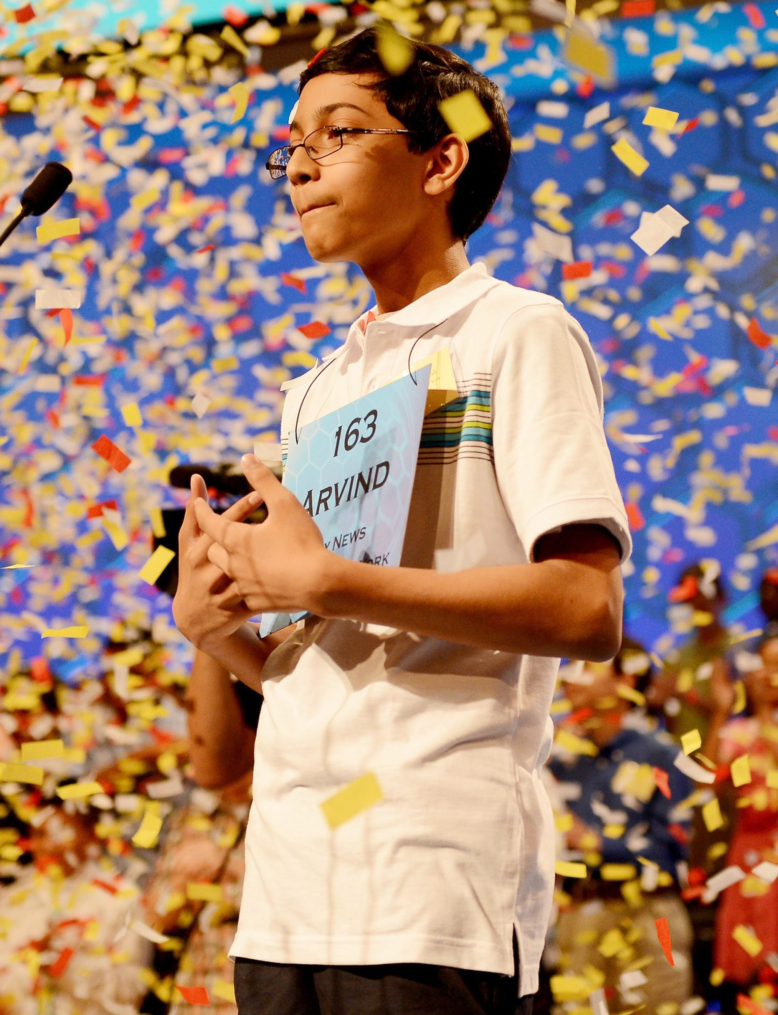 """Scripps National Spelling Bee winner Arvind Mahankali of Bayside Hills, New York, stands in a shower of confetti after he spelled """"knaidel"""" to win this year's Bee in National Harbor, Maryland, Thursday, May 30, 2013."""