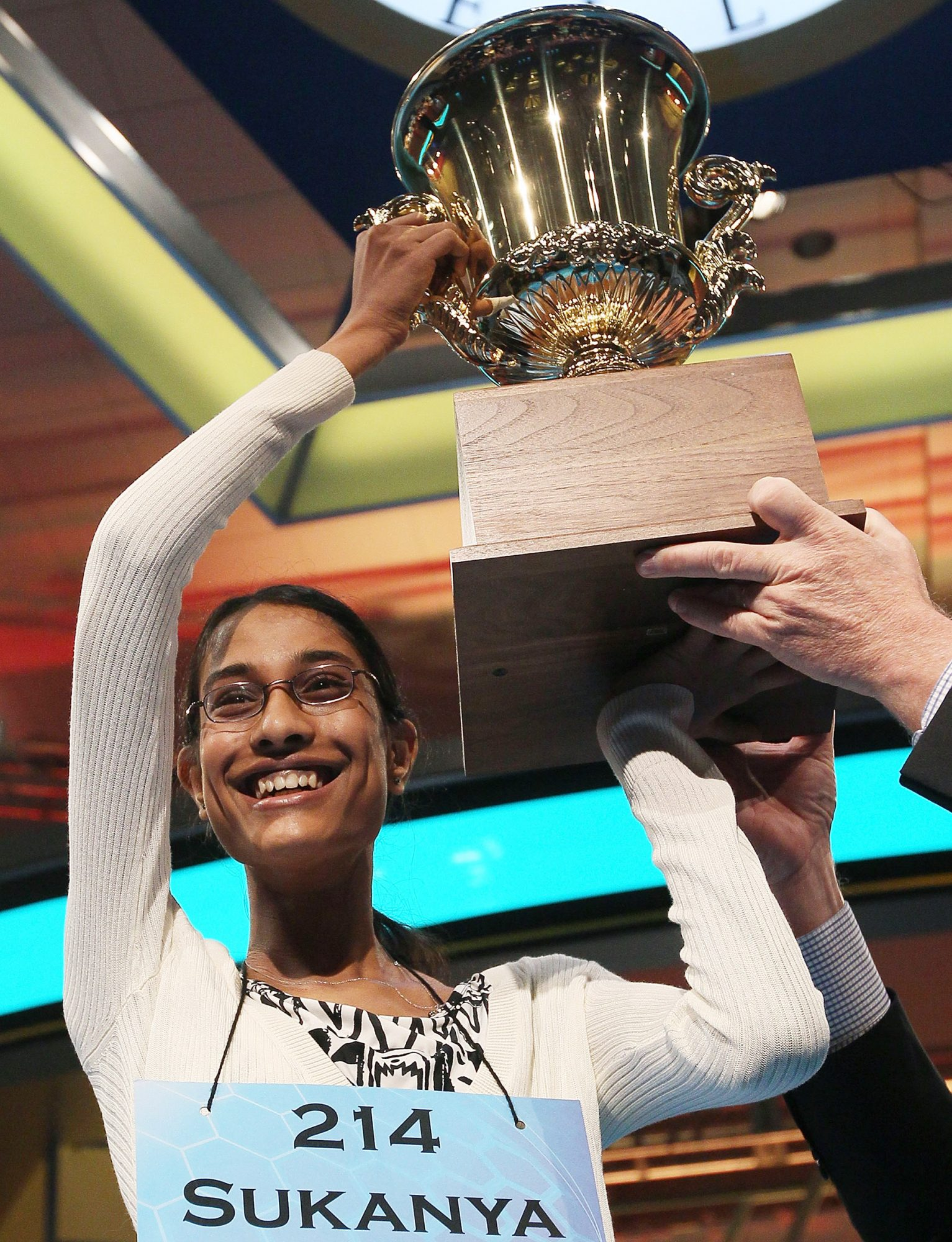 Sukanya Roy of South Abington Township, Pennsylvania holds up the trophy after winning the 2011 Scripps National Spelling Bee competition June 2, 2011 in National Harbor, Maryland