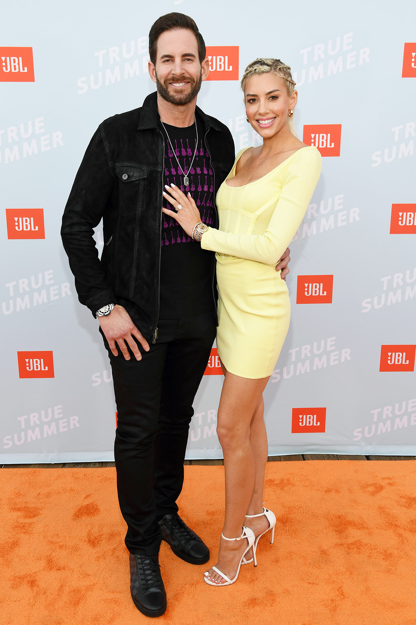 Tarek El Moussa and Heather Rae Young walk the red carpet at the JBL True Summer event. The exclusive event featured performances by DJ Sophia Eris, Bebe Rexha, and Jason Derulo. JBL is celebrating the return of live music with a donation to the National Independent Venue Association's (NIVA) #SaveOurStages initiative