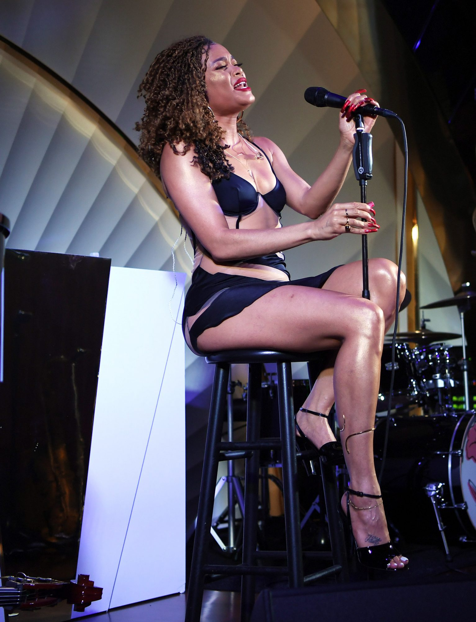 Andra Day performs onstage during Vegas Magazine's cover party with host Andra Day at h.wood Group's grand opening of Delilah at Wynn Las Vegas on July 08, 2021 in Las Vegas, Nevada