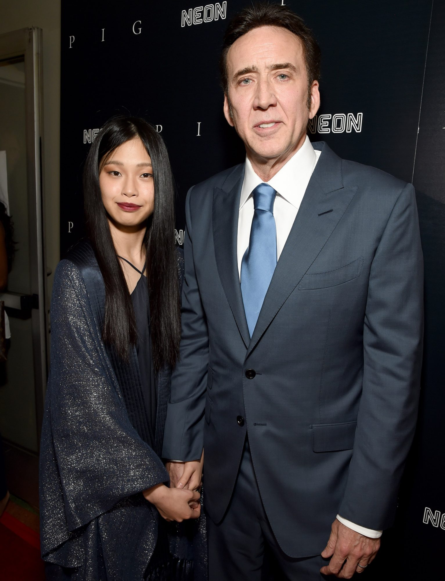 """Riko Shibata, left, and Nicolas Cage arrive at the Los Angeles premiere of """"Pig"""", at the Nuart Theatre"""