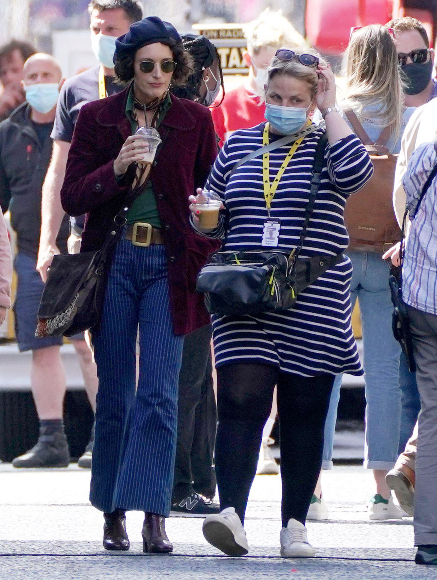 Actor Phoebe Waller-Bridge(L) on Cochrane Street in Glasgow city centre during filming for what is thought to be the new Indiana Jones 5 movie starring Harrison Ford. Picture date: Wednesday July 14, 2021.