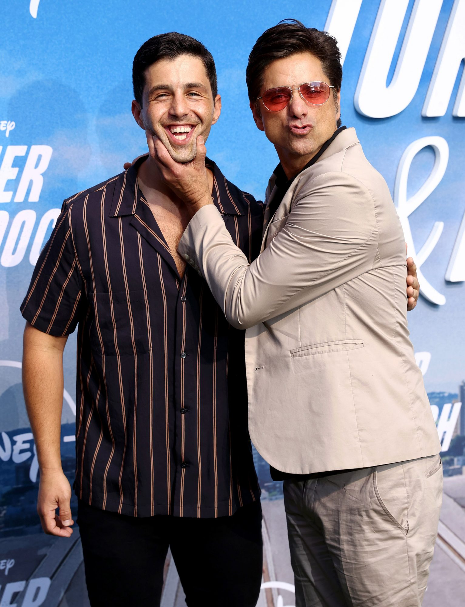 """Josh Peck and John Stamos attend the Disney+ """"Turner & Hooch"""" Premiere at Westfield Century City Mall on July 15, 2021 in Los Angeles, California"""