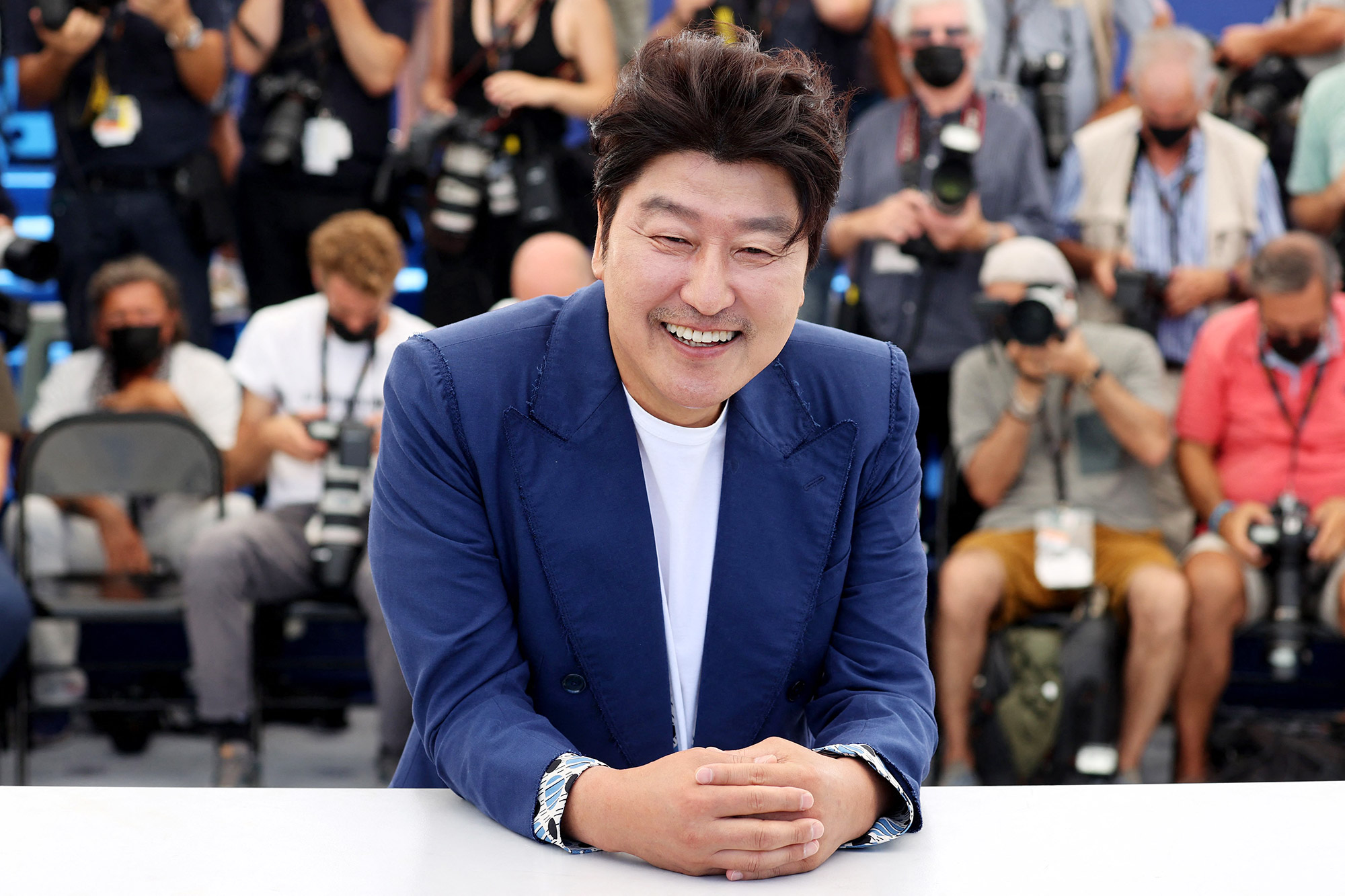 """South Korean actor Song Kang-Ho poses during a photocall for the film """"Bi-Sang-Seon-Eon"""" (Emergency Declaration) at the 74th edition of the Cannes Film Festival in Cannes, southern France, on July 16, 2021"""
