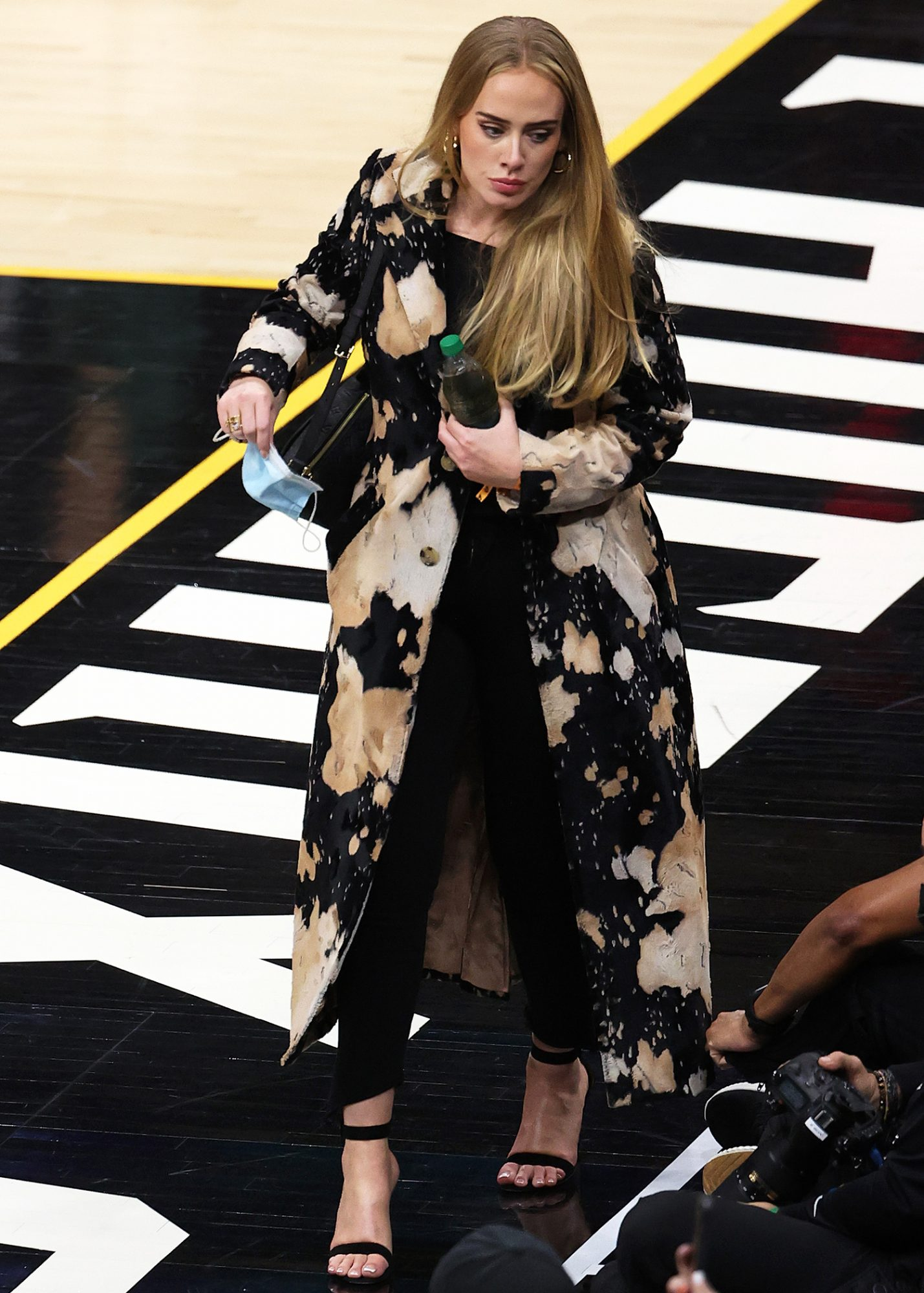 Adele looks walks in during the second half in Game Five of the NBA Finals between the Milwaukee Bucks and the Phoenix Suns at Footprint Center on July 17, 2021 in Phoenix, Arizona.