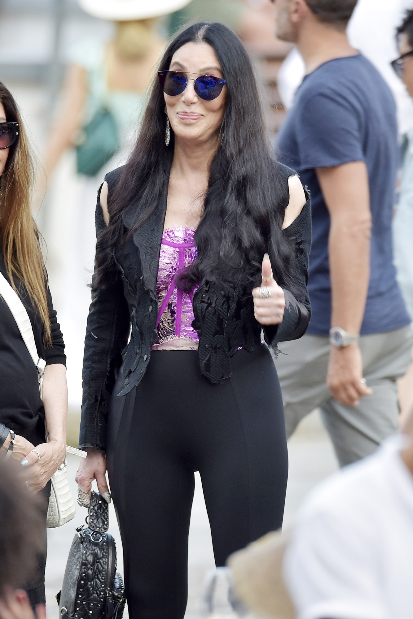 Cher enjoys the sights in Portofino after dining with friends.